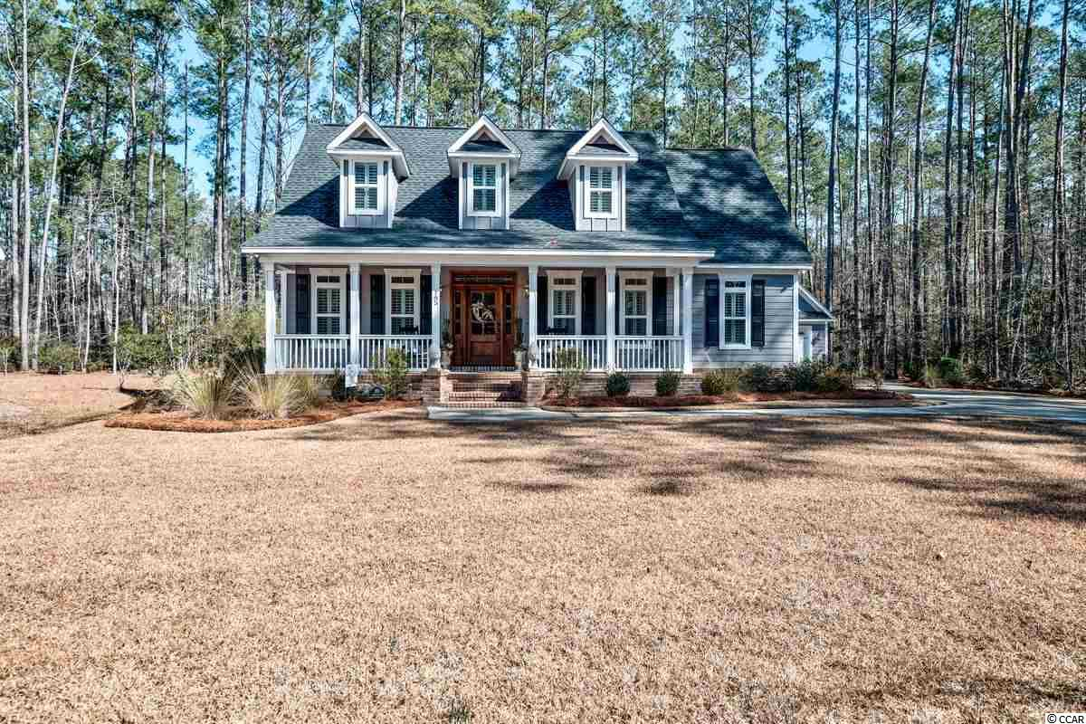 This is a rare opportunity to purchase a newly built custom home in Wedgefield Plantation; only 10 minutes from downtown Historic Georgetown. Located at the end of the cul-de-sac, 185 Joanna Gillard Ln renders all the details of the low country.  From the moment you open the front door you are greeted with 3 piece crown molding in the foyer, upgraded lighting and heart pine floors throughout the main living areas. Built in 2017, this home features 3 bedrooms, 2.5 bathrooms with the master on the main floor as well as formal living/office space and a formal dining room. The master suite has a vaulted ceiling overlooking the backyard. The master bathroom has a stand-alone tub and tiled shower. The kitchen features granite countertops, stainless steel appliances and a copper farm sink. Just off the kitchen is a walk-in pantry and laundry room. The living room includes a gas fireplace with a detailed mantle and shiplap. Upstairs has two bedrooms with ample closet space and a full bathroom with a double vanity.  Sit on either of the front or back porches to sip your morning coffee overlooking one of Wedgefield's ponds.  The exterior features hardiplank siding, a stained mahogany front door, copper lantern light fixtures, stained tongue and groove bead board ceilings on the porches and old Savannah brick for the front steps and foundation. Step into the backyard and enjoy a brick paver fire pit and gathering area. Wedgefield is a local golf course community that offers many amenities including a private boat landing with low HOA fees situated quietly on the Black River.