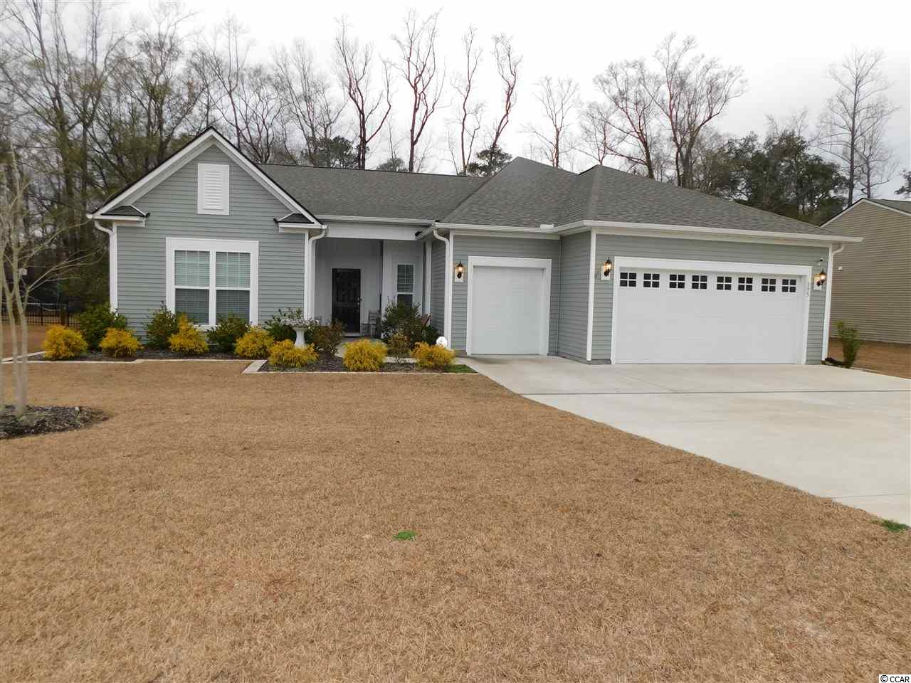 Heritage Preserve on Hwy 90...A Natural Gas Community. This home was built in 2018 with all the upgrades. Including but not limited to, engineered hardwood flooring crown molding and dual water meters. As you enter the home you'll see Custom Barn Doors to the office/bonus/flex room. Foyer leads into the spacious open-living area with great view of the backyard. Gorgeous gourmet kitchen features granite countertops, gas range w/ hood, walk-in custom pantry, upgraded cabinets with pullout drawers, and soft close doors and drawers! . Enclosed 4 Season Room at back of the house overlooks the preserve and it's part of the home lot. Very spacious Living/Kitchen/Dining area...perfect for hosting parties! Master suite shares the serene, wooded view and features tray ceiling, luxurious door less tiled shower, and super-huge walk-in closet. Your outdoor living space is ideal for entertaining with gas hook up, fire-pit, extended patio, and lawn irrigation Detached shed/storage with back deck for enjoying nature. Laundry/mud room, huge walk-up attic storage, epoxied 2-car + golf cart garage. Heritage Preserve is a natural gas community includes a spectacular community pool with kiddie area and pavilion, playground, and trash/recycle pickup. Flood insurance is NOT required. A less than 5-min drive to International Drive or Hwy 22 provides easy access to shopping, restaurants, amenities, and the beach!