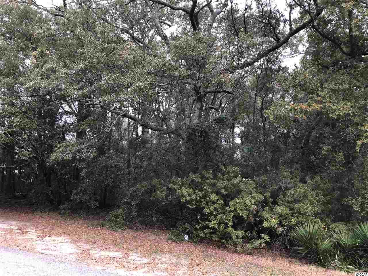 """What a great find! These lots seldom become available. It's one of a few lots left in coveted Arcadian Shores- a """"walk to the ocean"""" quiet community  with NO HOA that is tucked away and unknown to many, but cherished by all who live there. It's a perfect place to build your dream home. The sidewalked streets are flanked with mature trees, the lots are large, the homes are filled with character and not cookie cutter, and you can tell it's a well established neighborhood. A stone's throw from Arcadian Shores golf course, and also near to shopping, restaurants, theatres, Hwy 22 and 31, and of course the best part- a short walk or golf cart ride to the beautiful ocean! Build now and have a wonderful family home or get away, or wait as long as you want to build. No time frame, so it could be a perfect investment for your family for generations! Land near the beach- what could be better?"""