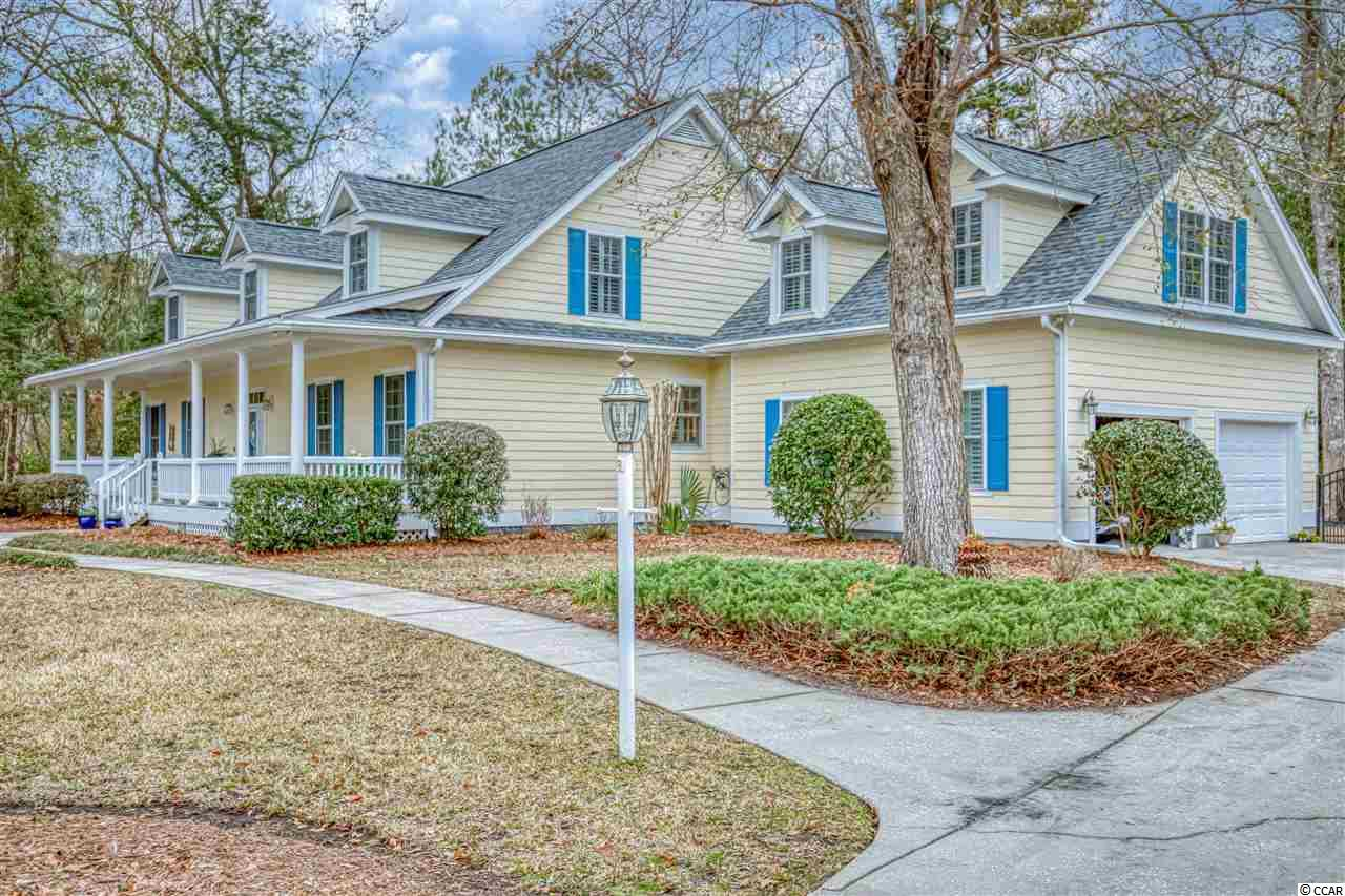 Welcome to 384 Old Augusta Drive! Located in the tranquil neighborhood of Pawleys Plantation, this custom-built Low-country style home sits on a huge private lot surrounded by beautiful oak trees,  landscaping and a fenced backyard. This 3 or 4 bedroom home offers 2.5 baths, an open floor-plan and ample room for entertaining. Both the great-room and  the larger Carolina room have fireplaces for coziness in the winter months and skylights that bring in lots of natural light. Both rooms open to a screened-in patio area under a pergola. The master bedroom, located on the first floor, has a tray ceiling, a fireplace and a separate sitting/reading area filled with natural light and its own fireplace. Two other bedrooms and a full bath are located upstairs with a balcony overlooking the great-room. Above the garage is a spacious and bright bonus/flex room that could be used as an office, exercise room or extra bedroom. Recent improvements include a new roof (Dec 2020), new AC unit (2020) and screened patio (Feb 2021). This home is nestled in the community surrounding the award-winning Jack Nicklaus-designed Pawleys Plantation Golf Club, one of the area's most challenging courses built along breathtaking salt marshes. A gated, secure subdivision, Pawley Plantation is only minutes from the best that Pawleys Island has to offer including restaurants, beaches, golf, and shopping.  Make plans now to see this beautiful low-country home. It will not last long in today's market