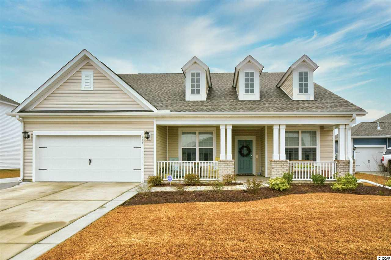 Welcome home to your beautiful new 3 bedroom/ 2.5 bathroom house! Located in Belle Mer, this home has an inviting exterior, and still feels just like new. Built in 2018, the house has remained in perfect condition. Cathedral ceiling with drop down fan in the living area, with an open concept floor plan. Separate formal dining room, with a gorgeous kitchen that has granite countertops, white cabinetry, an island, gas range, a pantry, and stainless steel appliances. The Master Suite offers tray ceilings, double sink vanity, tiled walk-in shower and walk-in closet. Second bathroom has a generous double sink vanity, shower/tub combo with a linen closet. Laundry room has utility sink and build-in shelving. Step out back to your own outdoor oasis! This fenced-in yard has a covered extended patio with a ceiling fan, a stone wall exterior, and a build-in fire pit. Belle Mer is a lifestyle family community that is a short drive away from beach access in Surfside. You can enjoy nearby shopping and dining that are minutes away, from Market Common to Coastal Grand Mall to Broadway at the Beach. Here you have access to the pool, fitness center, and community clubhouse. Schedule your appointment now, you do not want to miss this one!