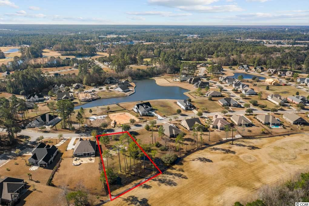 """One of the largest premium golf course lots at .61 acres located on the #2 Fairway of """"The Hummingbird"""" golf course in Wild Wing Lakes. The only lot left along this fairway. Every time you look out the windows of your new dream home, or relax in your back yard, you will feel like you are in paradise! Top of the line community amenities- 180 acres of lakes, 27 holes of golf, clubhouse with fitness center, driving range, 3 pools, water slide and kids area, day docks and boardwalk. Close to universities, Conway Hospital, downtown Conway, shopping, dining, and entertainment. Short drive to the beach and downtown."""