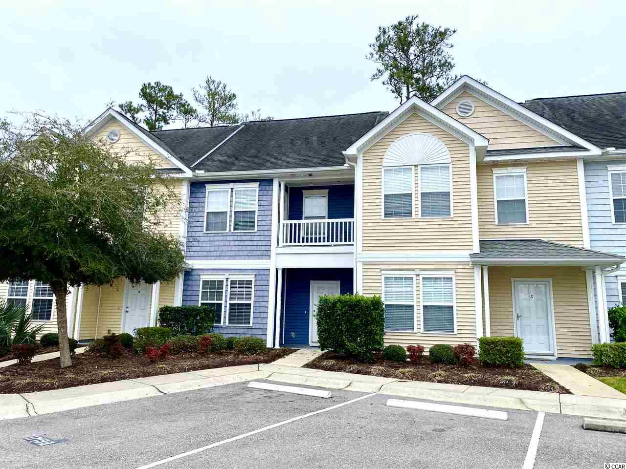 Convenient to everything!  This townhome style condo has 3 bedrooms, 2.5 bathrooms and sits in a quiet gated community.  Centrally located close to the Coastal Grande Mall, Broadway at the Beach, Myrtle Beach International Airport, Market Common and less than 3 miles to the beach.  Kitchen is well appointed with plenty of cabinets, classic granite countertops, and stainless steel appliances.  Off the large living room is a screen porch with an attached storage room.  There is a separate dining room which can also be a flex room.  A half bath, and a laundry area completes the first floor.  All bedrooms have cathedral ceilings and ceiling fans.  Owner's  bedroom has a walk in closet, owner's bathroom and a private balcony!  This unit has an interior sprinkler system, tile floors in the kitchen and bathrooms, and laminate flooring throughout.... NO carpet!  Low HOA dues include the community pool, landscaping, trash and exterior insurance.  Perfect for a primary, secondary or investment home.  This low maintenance living in the heart of Myrtle Beach with easy access to Hwy 501, 17 and 31 is the one you've been waiting for!