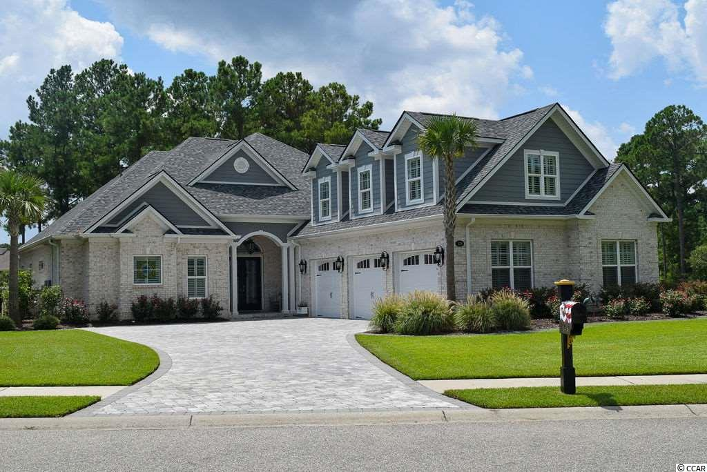 CONSIDERING southern coastal living? How about starting a new life chapter in one of the most sought-after communities in the Grand Strand, Plantation Lakes. Don't delay, schedule your personal tour today or visit an open house. This well-built brick TRANSITIONAL style custom home was recently built providing you more desirable open concept common area spaces, kitchen upgrades & appliances, enhanced flooring, over 10 foot ceilings, oversized rooms and so much more! Enjoying daily living in these common area spaces is a breeze as the kitchen, breakfast island & nook, livingroom and dining areas all compliment each other with ease – the only thing missing is you! Move throughout the main floor seamlessly as the owner's suite, second & third bedrooms, office, game room and laundry room are conveniently located here. The fourth over-sized guest/in-law suite is positioned on the second floor, thus providing additional privacy. Bring your measuring tape to find out just how large the oversized spaces and rooms really are – it's big (not too big)! And while you're at it – measure the large walk-in attic space!   For even more space, the oversized 3 car garage includes upgraded flooring, extra storage spaces, cabinets and closets to best serve your preferences. Check out the garage bathroom – what a smart design idea! Ask for more information on the whole house generator.   The home comes with many additional features that, even with great photography, seeing for yourself must be top of your TO-DO list. Here are a few features to share: owner's suite lounge area & closet spaces, owner's suite oversized shower, upgraded tile flooring throughout entire main level, upgraded plumbing & lighting fixtures, trey ceilings, upgraded countertops, custom cabinets & hardware, upgraded fireplace, instant hot water system under kitchen sink, tankless water heater, 3 zone HVAC, wainscoting and beadboard wall & door accents, subtly painted walls, oversized bedrooms each with a private full bathroom, home security system, newer landscaping and curbscaping, outdoor lakeside living and more!   When property location matters, this lot is the TOP selection as it's positioned on a desirable street, next to a wooded preserve area, overlooking a large lake. You have both the large lake view accompanied with a wooded lot view – a rarity in Plantation Lakes. You may want to consider adding a boat slip as boating on the lakes is a favorite past time for us southerners. This lot is so wonderful even a family of swans frequent the property! BONUS – across the street is another wooded preserve area.   This desirable community provides resort style living with top-tier private amenities and events for all ages, to name a few: established landscaping, multiple pools, clubhouse & fitness center, community events, gated playground, tennis courts, basketball court and even permission to use POWERED BOATS throughout the many miles of lakes – for the outdoor enthusiast, this community even has double sidewalks on ALL streets! Plantation Lakes is only minutes from the beach, Intracoastal Waterway, grocery, shopping, spa, fitness, golf, bike riding, shooting range, restaurants, healthcare, top-tier schools, international airport and much more - you'll love it! Even Mister Softee ice cream truck visits weekly – it's delicious! Ask an established Realtor for a TOUR of the community & home as there's so much to discover. You'll love buying this turnkey dream home located in arguably the best neighborhood in Carolina Forest! Schedule your showing today - don't delay.
