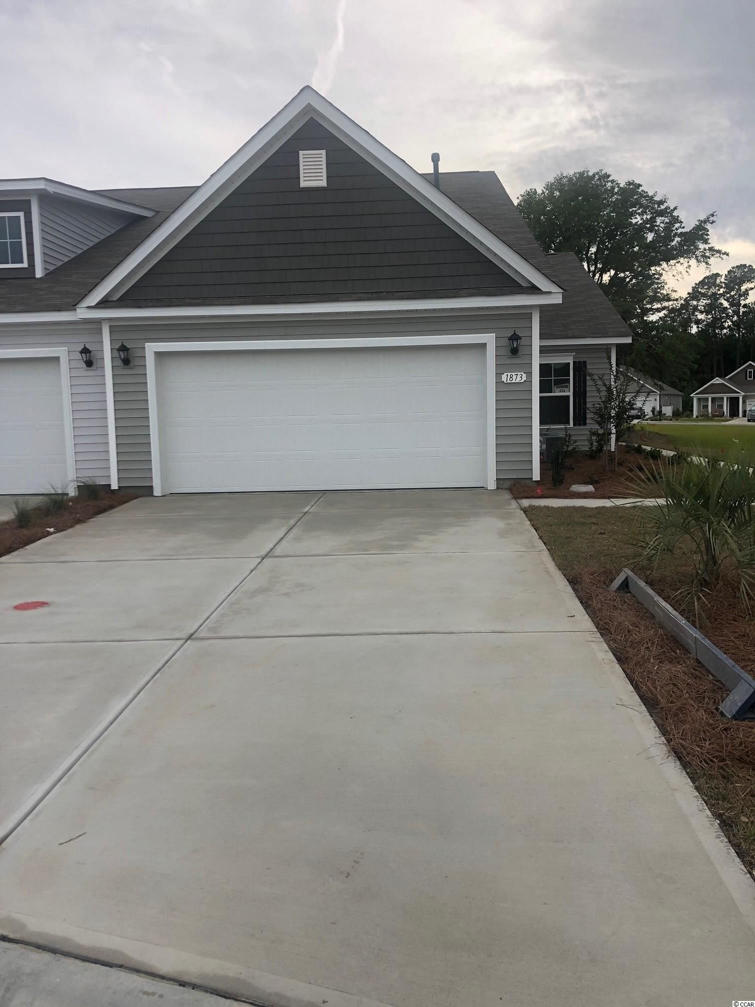Lovely, low maintenance, paired ranch home in a brand new community! This Tuscan floorplan offers a spacious, open layout all on a single level. With vaulted ceilings, tons of natural light throughout the living and dining areas, large kitchen island, and spacious covered porch, this home is perfect for entertaining! The kitchen also features granite countertops, stainless Whirlpool appliances, white painted cabinetry, and a large pantry with ample storage. Roomy primary bedroom suite with walk-in closet and private bath with dual vanity and 5 ft. walk-in shower. This home also features laminate wood flooring throughout the main living areas, a tankless gas water heater, and our industry leading smart home technology package. Yard and exterior maintenance are all covered! 4' black aluminum fencing is permitted (per HOA approval).  *Photos are of a similar Tuscan home. (Home and community information, including pricing, included features, terms, availability and amenities, are subject to change prior to sale at any time without notice or obligation. Square footages are approximate. Pictures, photographs, colors, features, and sizes are for illustration purposes only and will vary from the homes as built. Equal housing opportunity builder.)