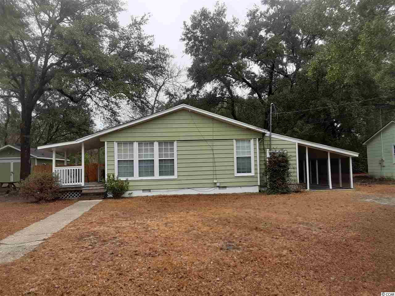 3 bedroom 2 bath located in the Maryville section on Georgetown. Just minutes from the downtown Historic District shopping and dining. It is 30 miles south of Myrtle Beach and 60 miles north of Charleston. Has a fenced in back yard, 12 x 20 workshop with A/C. 10 x 18 screened in porch. Hardwood floors. Great starter home or investment property. Square footage is approximate and not guaranteed. Buyer is responsible for verification.
