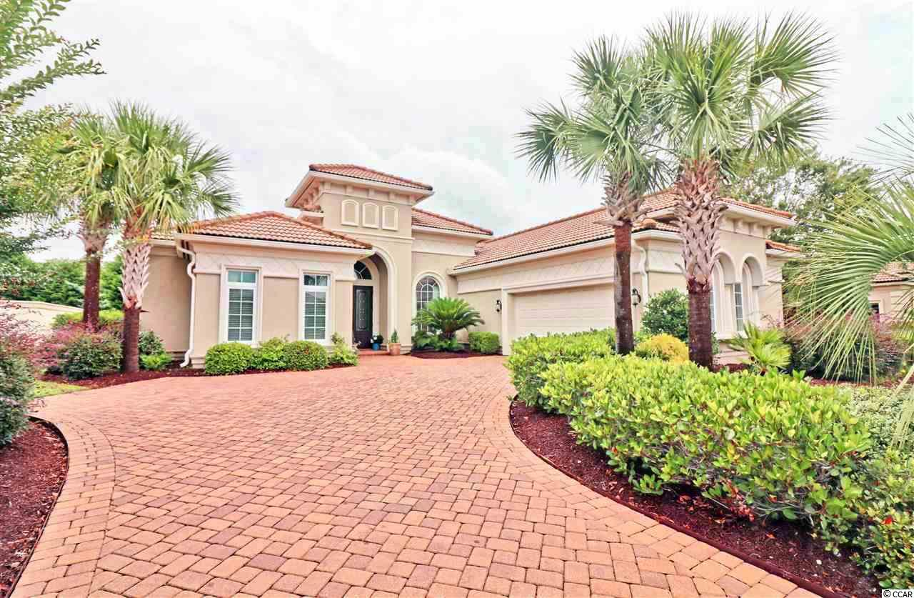 """Top Reasons you'll want to be graced by this 3 BD, 2 1/2 BA, modern style fortified ICF solid Mediterranean home that has a simplistic open floor plan with lots of light. The wood and tile floors detail clean lines throughout. Stone fireplace, new countertops,replaced the dark granite with white quartzite,beautiful cabinetry, breakfast bar, stainless steel appliances, new refrigerator, gas stove, tray ceilings and screened in back porch. Plenty of backyard space. You're a member of the Grande Dunes Ocean Club with ownership living in gated  Seville is a great walkable,bike and golf cart neighborhood , close to shopping, dining, and under a mile from Grand Strand Medical Center.Owners at the Grande Dunes enjoy an exquisite Ocean Club that has fine dining, Ocean Front Pools,chairs on the Beach,  and a place for events. The Grande Dunes boast two prestigious 18 hole golf courses. Resort course is open to the public and the Nick Price designed """"Members Club"""" is open to members. Other features are a deep water marina, and state of the art tennis facility.Come Live the Grande Dunes Experience!"""