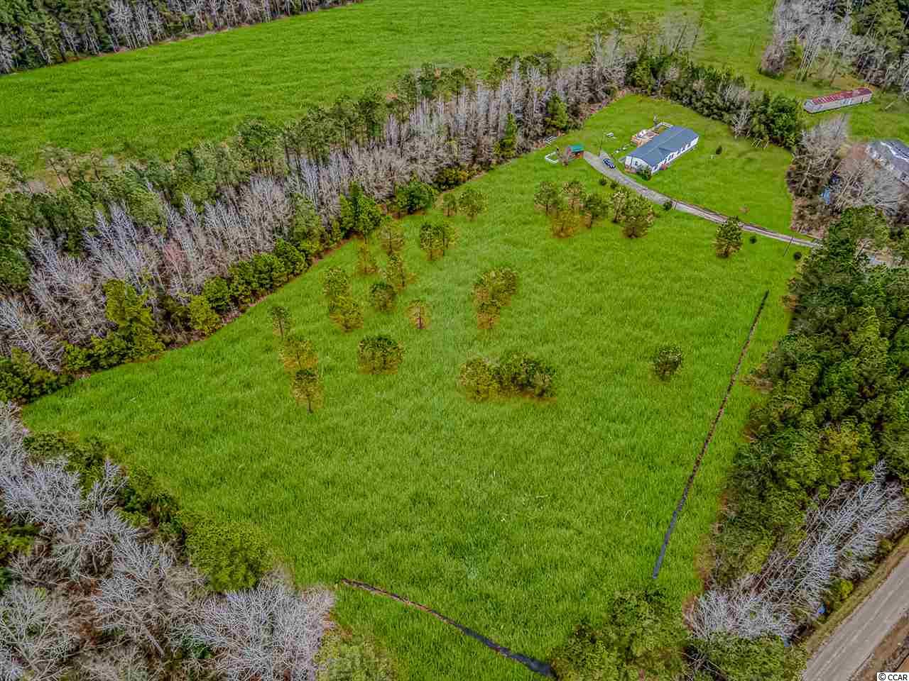 If you've been looking for your own slice of heaven that is already cleared and ready to go, look no further. This land has been zoned for 5 homes or you can just keep it all to yourself. Water and electric have been ran to the site so just pull your permits and enjoy your private 6 acres. The land is located conveniently just south of downtown Conway. So although you're out in a rural area with no close neighbors, you can still be downtown in minutes and you're not far out from the beach either. It is rare to find acreage in such a great location. You won't find cleared parcels this size with utilities ran to them already. Drive by anytime and check it out before it's gone!!!