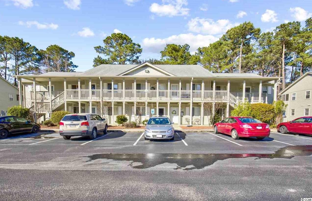 This property in the sought-after Island Green Community in Myrtle Beach is perfect for a primary, secondary, or vacation home at the beach. Additionally, it can be used for short or long-term rentals when not owner-occupied. This home is located a short 7 miles from beautiful Surfside Beach and Pier.  This home is ideally located across and the parking lot from one of two community pools. The pool is also visible from the home's front porch. Enjoy nature from the enclosed rear balcony day or night.  The Island Green Community has a low HOA which includes two pools, insurance, water, cable, security, and much more. Island Green Resort provides live night-time security. The optional amenities center includes a fitness center, indoor pool, hot tub, and a variety of social activities for a low fee (because of COVID-19, accessibility may fluctuate). The current owners are very motivated to sell and will entertain any offer. Flooring allowance provided with accepted offer.
