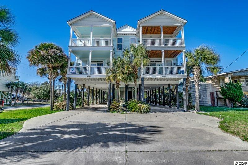 "Amazing opportunity to purchase this Second Row 5 bedroom 5.5 bath Raised Beach Home w/ private pool in Garden City Beach ! Known as ""Cool Breeze"", 1201-A N Waccamaw Drive offers ocean views, has a public beach access just directly across the street, and is less than a mile to Garden City Pier ! The spacious interior floor plan is perfect for large families with two master suites, two large bedrooms and a unique nautical themed bunk room for the kids. All bedrooms have a private bath. The half bath is located downstairs on main level and the kitchen features stainless steel appliances, granite countertops, and breakfast bar. Outdoor amenities include a walk-out covered porch, private 12x19ft (5-ft deep) swimming pool, fencing, outdoor shower, charcoal grill, and ample parking underneath. No HOA ! Close to everything the Grand Strand has to offer--shopping, dining, entertainment, golf, Murrells Inlet Marshwalk, Marlin Quay Marina, and much more ! Whether you are looking for a permanent residence, a vacation get-a-way, or an investment property, you won't want to miss this one....schedule your showing today!"
