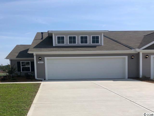 Lovely, low maintenance, paired ranch home in a brand new community! This Tuscan floorplan offers a spacious, open layout all on a single level. With vaulted ceilings, tons of natural light throughout the living and dining areas, large kitchen island, and spacious covered patio, this home is perfect for entertaining! The kitchen also features granite countertops, stainless Whirlpool appliances, white painted cabinetry, and a large pantry with ample storage. Roomy primary bedroom suite with walk-in closet and private bath with dual vanity and 5 ft. walk-in shower. This home also features laminate wood flooring in the main living areas, a tankless gas water heater, and our industry leading smart home technology package. Yard and exterior maintenance are all covered! 4' black aluminum fencing is permitted (per HOA approval).  *Photos are of a similar Tuscan home. (Home and community information, including pricing, included features, terms, availability and amenities, are subject to change prior to sale at any time without notice or obligation. Square footages are approximate. Pictures, photographs, colors, features, and sizes are for illustration purposes only and will vary from the homes as built. Equal housing opportunity builder.)
