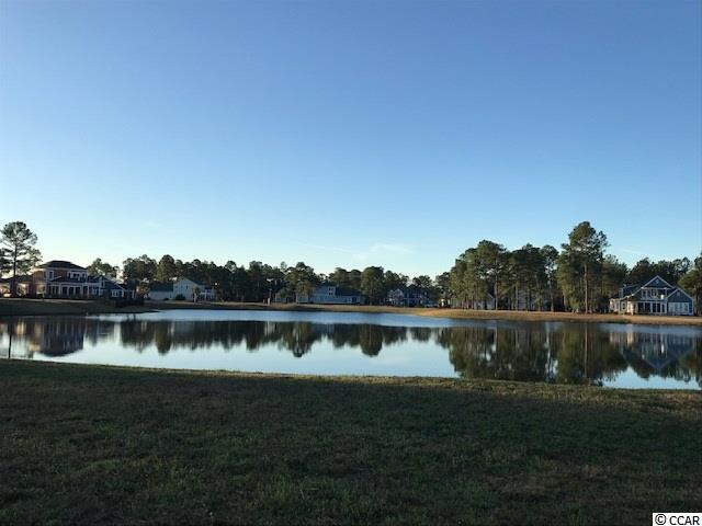 Beautiful DOUBLE .47 acre Lake Front Lot in the gated community of Waterbridge. Perfect location for your Dream Home! This lot offers stunning  water views and is an easy an easy walk to ALL of the amenities the community has to offer. Amenities include an amazing pool area, fitness center, walk down fire pit, swim up refreshment bar, tennis courts, volleyball and basketball courts,  boat ramp and pier. Located in the heart of Carolina Forest.  No timeframe to bring.  Bring your own builder.
