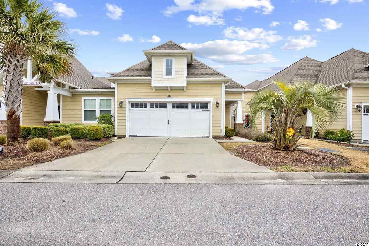 """4 Bedroom, 3.5 Bath Townhome with a 2-car garage in Clearwater Bay at Barefoot Resort shows like a model home. Entire unit is newly painted.  Enter the spacious foyer complete w/tray ceiling, crown molding detail and ceramic tile floors. The Kitchen has  42"""" Raised Cherry cabinets, glass tile backsplash, Under cabinet lighting, granite counter tops w/bar top, stainless steel appliances and opens to your private courtyard. Continue into the dining and living areas that boast hardwood floors and a screened-in porch, just off the living room. Master Suite is on the main level. Tray ceiling in master, walk-in closet, double sinks, separate garden tub and shower. Upstairs the large bonus room has a pool table and poker table to keep you and guests entertained.  Upstairs are 3 bedrooms and 2 full baths. One spacious bedroom with 2 queen beds has its own private bath while the other 2 bedrooms (each with a queen bed) share a large bath with a double vanity sink. 2 car garage w/attic storage. Barefoot residents have access to: Oceanfront Beach Cabana w/Shuttle Service, 15,000 Gallon Saltwater Pool, Clearwater Bay Clubhouse w/Pool, Golf Membership, Barefoot Resort Clubhouse w/on-site restaurant and golf pro shop. Don't miss out on our fastest selling maintenance free homes! HOA Fee includes Basic Cable, Phone, Internet, Monthly Security Monitoring as well as building maintenance and insurance, termite bonds, reserves, water and sewer, trash pickup, etc.  Spacious layout is perfect for everyday living or a 2nd home/rental at the beach. TRANSFERRABLE GOLF MEMBERSHIP."""