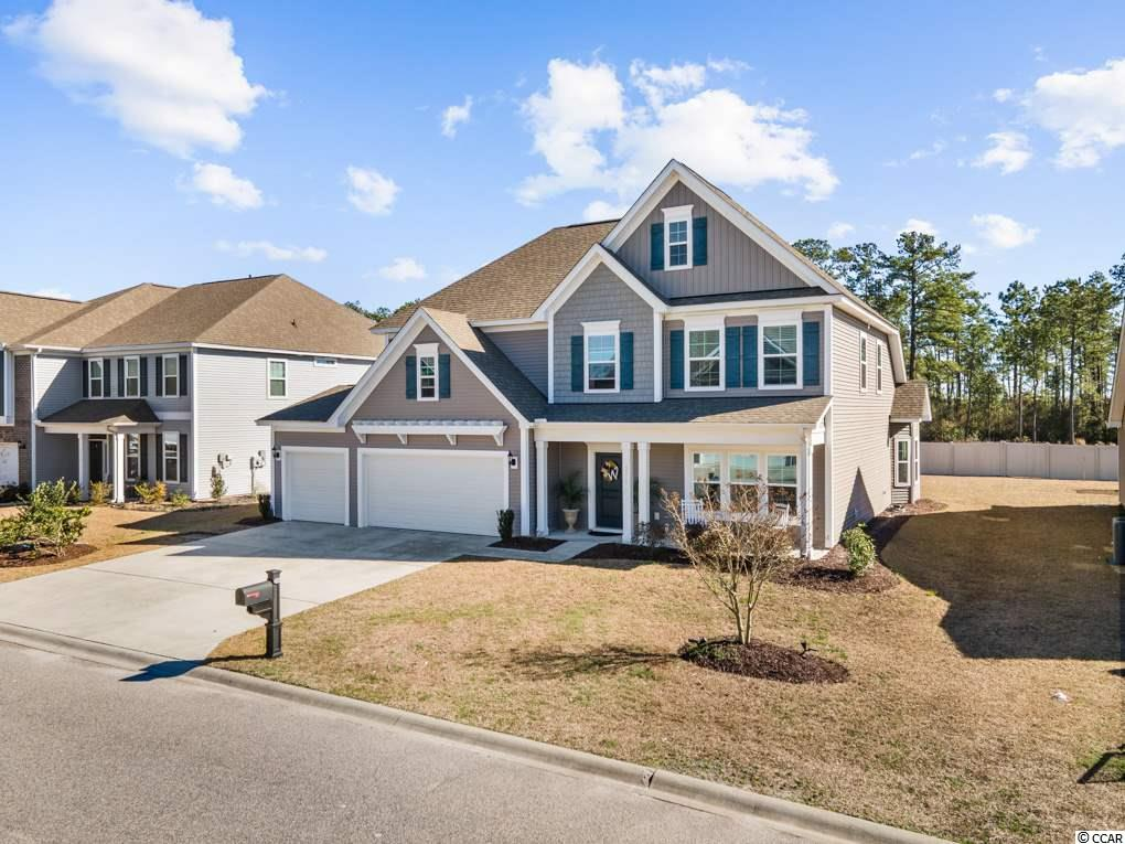 WOW!!! 3252 Saddlewood Circle is Large 5BR/3.5BA Home, located in the highly desirable Clear Pond development of Carolina Forest. Boasting over 3,600 Heated sqft, and just over 4,400 sqft under roof, this home is sure to impress! Step inside and you'll immediately notice how warm and inviting the home feels. You'll appreciate the abundance of natural light in the main living space, and find flooring materials such as wood, tile, and carpet used throughout. As the seasons change, you'll enjoy sitting by the fireplace, or sipping your morning coffee inside the screened-in porch. In the kitchen, custom cabinetry line the walls, accompanied by stainless steel appliances, including gas range, tiled backsplash and granite countertops. You will appreciate the efficiency of the two tankless hot waters, and the overall size of the three car garage and workspace. This split floor plan offers an over-sized Master BR complete with walk-in closet, Master BA with dual vanity, jacuzzi tub, and stand up shower. The bonus room is also a large space and currently being used as the movie room. The large patio out back is perfect for a variety of  entertainment ideas, and there's even enough room for a pool should you desire! Located just minutes from the sought after Carolina Forest Schools, shopping, dining, and a short 10 minute drive to the gorgeous sandy beaches! Whether you are looking for a primary residence, or a 2nd home, this may be the perfect fit! Lock-in your private tour today! All measurements are approximate and not guaranteed. Buyer is responsible for verification.