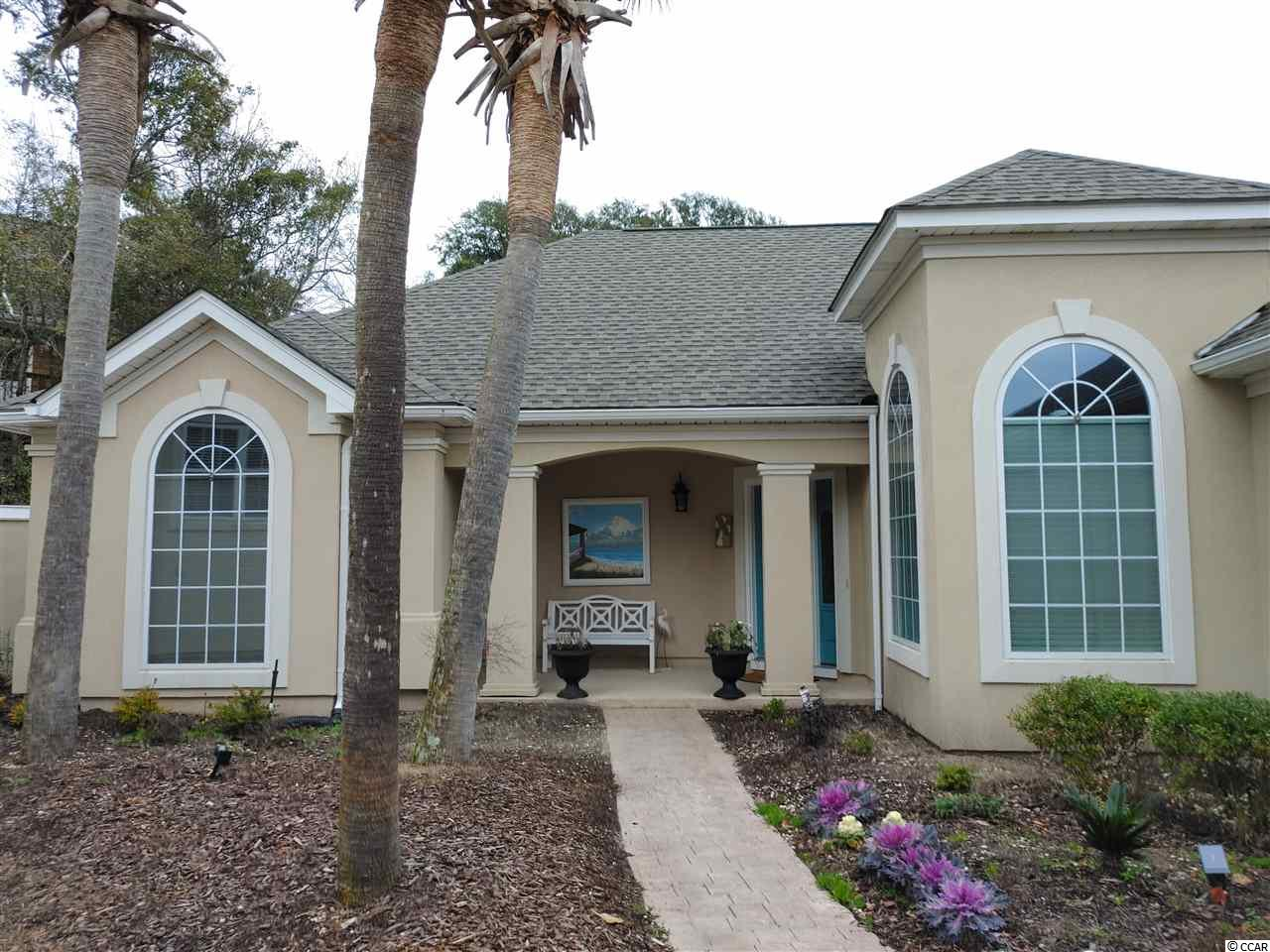 YOUR Private Oasis by the Sea!  A well maintained, professionally decorated-furnished, POOL home located in the gated community of the Heights at Windy Hill is on the market!. Located east of Hwy 17, this 3 bedroom, 2 bath home is highlighted by a private backyard oasis with a inground concrete pool new pavers & recently updated landscaping were all completed in 2021. This home has one of the largest yards/lots in the community. With an Open - floor plan concept - the 2100 sq ft floor plan is very desirable! There is plenty of room for the family and for entertaining guests. Designer furnishings complete this home giving you that true Beach Home Vibe. The Roof, HVAC, dishwasher, wood-like tile flooring in bedrooms and hallway, & lighting fixtures throughout the home were all updated in 2015. In 2018, water heater & crown molding throughout the home were installed. Beautiful tile flooring is throughout the living areas, The eat-in kitchen features Corian-style countertops, designer backsplash, ample cabinets with under cabinet lighting, stainless steel appliances, (New refrigerator 2020) breakfast nook, and breakfast bar.  Formal dining room has a designer beach chandelier and two large windows with palladium accent windows above. While relaxing in the living room, You can cozy up to the gas log fireplace on those chilly nights. There is a spectacular Carolina room with  gorgeous views of the backyard and pool. Your large master bedroom has a walk-in closet, and a door to the Carolina room.  Both guest bedrooms have nice-sized closets and ceiling fans. In the attached 2-car garage, you will find lots of built-in storage cabinets, a mud sink,epoxy flooring, pull-down stairs to attic, and a side door. But the outside is where you meet paradise! The completely fenced backyard is full of beautiful yet low-maintenance RELAX in you inground, concrete 3'-5' deep pool. The right side of the back yard has NEW paver walkway .The left side has a secluded area - the possibilitie