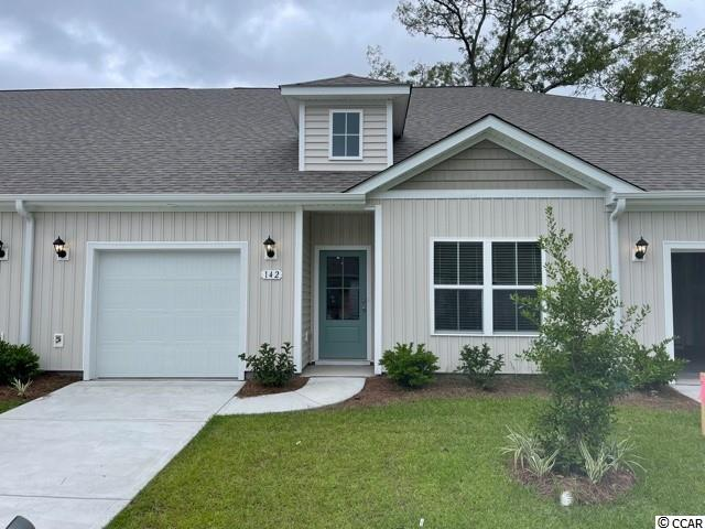 Brand new community within walking distance to the Murrells Inlet Marsh Walk! Low maintenance living at its best with these single level townhomes. Our Bentley floorplan is masterfully designed with an open concept kitchen, living, and dining area that is perfect for guests visiting you at the beach! Features include white painted cabinetry, granite counters in the kitchen, stainless Whirlpool appliances, and laminate wood flooring that flows throughout the main living areas. This home also boasts a versatile flex space that would make a great formal dining room or home office. The primary bedroom suite is tucked away at the back of the home with a walk-in closet along with a private bathroom with dual vanity and large shower. Enjoy the beautiful coastal weather on the rear covered porch! One-car garage with garage door opener plus a spacious storage closet off the rear porch. It gets better- this is America's Smart Home! Ask an agent today about our industry leading smart home technology package that is included in each of our homes.  *Photos are of a similar Bentley home. This home is under construction. (Home and community information, including pricing, included features, terms, availability and amenities, are subject to change prior to sale at any time without notice or obligation. Square footages are approximate. Pictures, photographs, colors, features, and sizes are for illustration purposes only and will vary from the homes as built. Equal housing opportunity builder.)