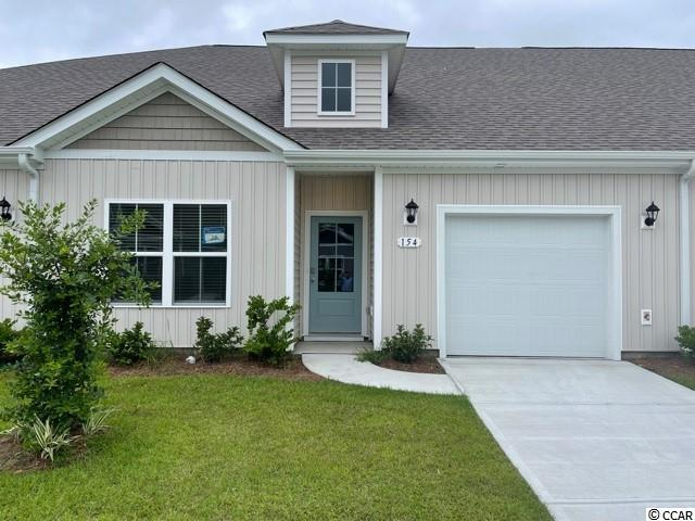 Brand new community within walking distance to the Murrells Inlet Marsh Walk! Low maintenance living at its best with these single level townhomes. Our Bentley floorplan is masterfully designed with an open concept kitchen, living, and dining area that is perfect for guests visiting you at the beach! Features include white painted cabinetry, granite counters in the kitchen, stainless Whirlpool appliances, and laminate wood flooring that flows throughout the main living areas. This home also boasts a versatile flex space that would make a great formal dining room or home office. The primary bedroom suite is tucked away at the back of the home with a walk-in closet along with a private bathroom with dual vanity and large shower. Enjoy the beautiful coastal weather on the rear covered porch! One-car garage with garage door opener plus a spacious storage closet off the rear porch. It gets better- this is America's Smart Home! Ask an agent today about our industry leading smart home technology package that is included in each of our homes.  *Photos include renderings of the Bentley floorplan. This home is under construction. (Home and community information, including pricing, included features, terms, availability and amenities, are subject to change prior to sale at any time without notice or obligation. Square footages are approximate. Pictures, photographs, colors, features, and sizes are for illustration purposes only and will vary from the homes as built. Equal housing opportunity builder.)