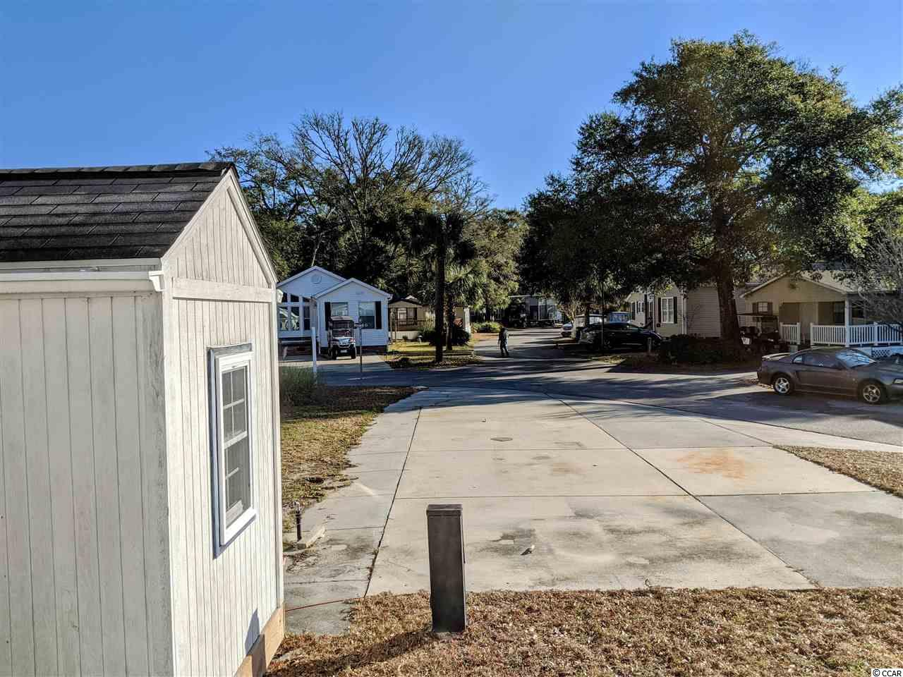 "Looking to begin ""Living The Salt Life"" - this great corner lot is positioned across the street from the marsh in the Cherry Grove section of NMB in the MB RV Resort.  After a day on the beach, you will enjoy the breeze right off of the ocean with the water just steps away.  This lot is perfect for a park model or parking your RV.  This is your chance for a beach getaway of your very own.  The MB RV Resort community offers 2 swimming pools, a basketball court, access to the marsh for fishing and kayaking, a club house and an activity center.  The HOA fees cover water, sewer, trash, cable, internet and access to these great amenities."