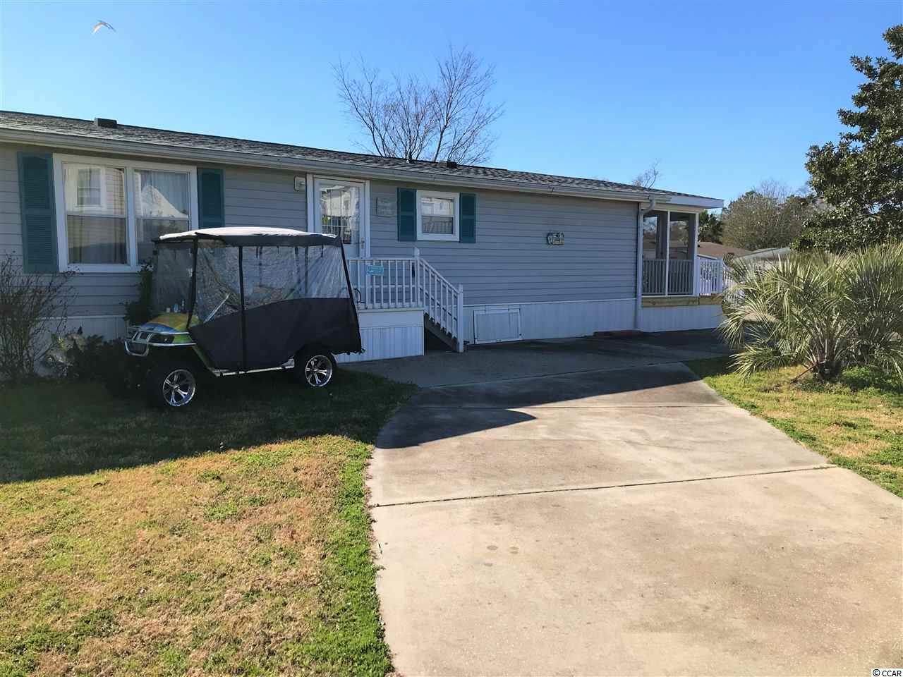 Lovely 3 bedroom 2 full bath home that has been totally renovated.  New stainless appliances and furnishings  with updated wood laminate and tile flooring.  New HVAC system, duct work and plumbing 2020.  Architectural shingled roof - 2018.  Screened in porch for those lazy afternoons.  Large living area - flat screen television and sliders leading out to newly added enclosed porch with stone e-facing.  Master bedroom with access to large bathroom with new vanity and decor.  Second and third bedrooms share full bath with walk in shower and new vanity.  Oceanside Village offers two outdoor pools and water parks, indoor pools, fitness and community centers, basketball courts and of course OCEAN FRONT GOLF CART PARKING FOR OWNERS AND GUESTS beside the Conch Cafe.