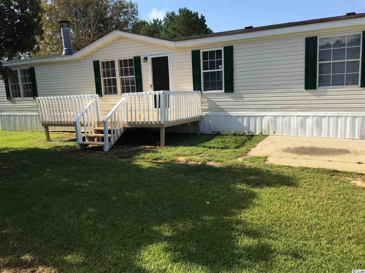 Beautiful home on the lake with a large living room with a fireplace. Large front porch to stretch out and relax or go fishing behind the house.