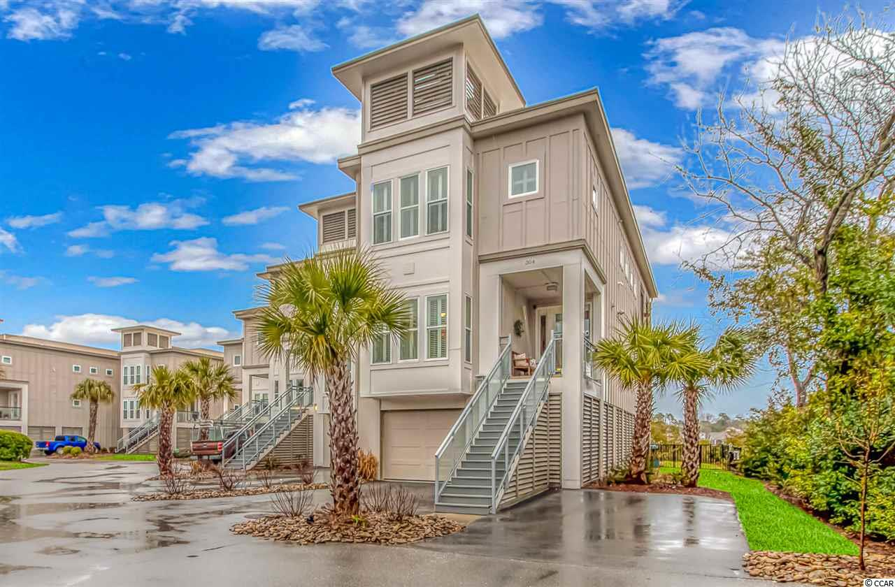 The Vues on 48th are a small group of modern luxury homes built alongside the marsh across from Barefoot Landing. The Vues on 48th are also within a short distance to the ocean, shopping, restaurants, and attractions. This three level home offers ground level parking for two vehicles and a golf cart.  The first floor has a bedroom / office, full bath, an eat-in kitchen, formal dining area, outdoor porch and spacious living room. The top level includes a grand master suite with an outdoor covered balcony, and two additional bedrooms with full baths. This luxury villa has its own private heated salt water pool with larger patio and more privacy being an end unit.  Private elevator to all three levels.  The ground level has a half bath, storage rooms and recreation living space to retreat from the sun by the poolside.  This room can be closed off by a roll up door.  The home features motorized blinds in the living room and master bedroom.  Each balcony has ceilings fans and motorized screens.  Feature list:  fiber cement exteriors, solid core doors, tile flooring,  gas heating, ceiling fans and designer lighting, stainless steel appliances, deluxe cabinets and granite counter tops. Master bath has tub, tile shower and cultured marble counters, built-in pest control, outdoor shower.