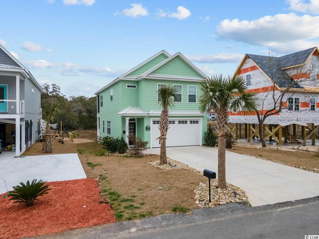 Sit on your back deck and watch the boats go by from this Marsh view home in  beautiful Little River. This home is 3 bedrooms and 2.5 baths with tile and LVT floors, granite countertops, stainless appliances, tiled master shower, Hardi Plank siding, metal roof and No HOA fees's. Only a few miles to NMB and Hwy 31 and minutes to Calabash. Home is only 4 years old and is not in a flood zone.