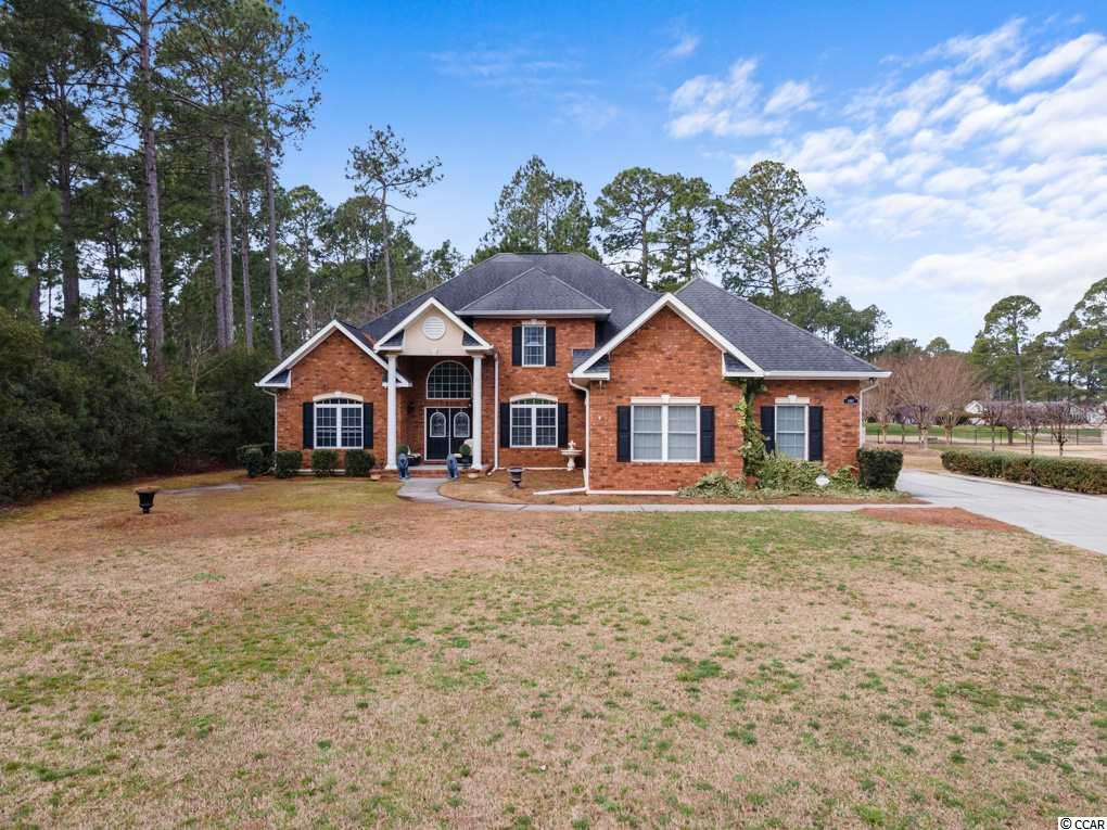 Come see this beautiful custom-built all brick home in the Southcreek section of the popular Myrtle Beach National Golf Club!  As you walk into the two-story foyer, you will see the beautiful staircase leading to an upstairs foyer.  Hardwoods are on display throughout the main living areas of the home with tile in the kitchen and bathrooms, and carpet in the bedrooms. There is an office area with cathedral ceilings as well as a formal dining area with tray ceilings.  Enjoy the kitchen with granite countertops, stainless steel appliances, and built-in cabinets for additional storage.  The sunken den is extra cozy with the fireplace and high ceilings. The master suite and one guest bedroom is on the main floor with 3 additional bedrooms upstairs. There is another full bath on the main level and a Jack and Jill bath connecting two of the upstairs bedrooms plus another full bath upstairs.  Need an extra space for a movie or game room, there is a bonus room for that!  This home also has a huge 3 car garage with a long driveway!  There is a view of the golf course from both the front and back of this home.  Don't miss out on this beautiful home!