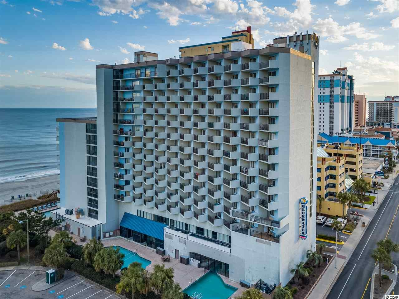 Fantastic One Bedroom Sleep 6 Ocean View Retreat at Bluewater Resort with 180 Degree Panoramic View, Beautifully Furnished and Decorated, A Must See Property! Fantastic Northeast Sunrise Views!  Large Flat Screen TV's in Bedroom and Living Room, Two Ottomans is Living Room That Open To Singe Beds. Kitchen Features, Stovetop, Oven and Microwave. Bluewater Resort Has Great Amenities Including Indoor and Outdoor Pools, Hot Tubs, Lazy River, Shuffleboard, Racquetball, Mako's Restaurant and Bar, Seasonal Tiki Bar and Convenient Laundromat HOA Also Includes Building Insurance and Electric in the Unit. Great Beach Front Investment Property, just minutes to all our beautiful sandy beaches, public piers, marinas, boat landings, public parks and restaurant/shops. Conveniently located in the vicinity of everything Myrtle Beach has to offer including: Myrtle Beach International Airport, The Market Common, Coastal Grande Mall, Tanger Outlet Centers, Over 80 golf courses, 5 major hospitals and 2 colleges.