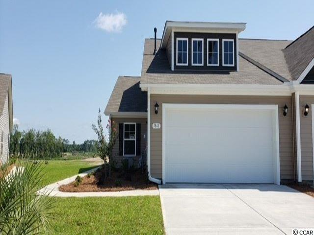 Lovely, low maintenance, paired ranch home in a brand new community! This Tuscan floorplan offers a spacious, open layout all on a single level. With vaulted ceilings, tons of natural light throughout the living and dining areas, large kitchen island with breakfast bar, and spacious covered patio, this home is perfect for entertaining! The kitchen also features granite countertops, stainless Whirlpool appliances, white painted cabinetry, and a large pantry with ample storage. Roomy primary bedroom suite with walk-in closet and private bath with dual vanity and 5 ft. walk-in shower. This home also features laminate wood flooring in the main living areas, a tankless gas water heater, and our industry leading smart home technology package. Yard and exterior maintenance are all covered! 4' black aluminum fencing is permitted (per HOA approval).  *Photos are of a similar Tuscan home. (Home and community information, including pricing, included features, terms, availability and amenities, are subject to change prior to sale at any time without notice or obligation. Square footages are approximate. Pictures, photographs, colors, features, and sizes are for illustration purposes only and will vary from the homes as built. Equal housing opportunity builder.)