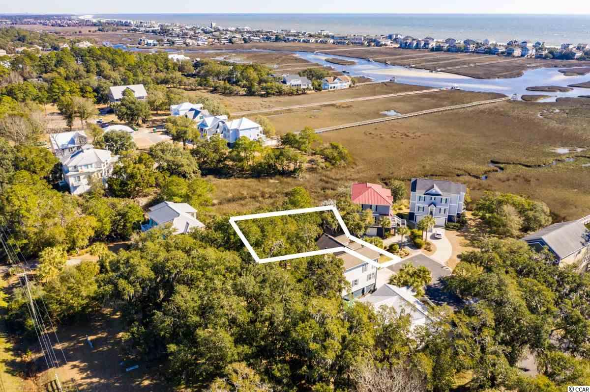 Such a unique spot with marsh and creek views from the Litchfield Mainland!  One of only a few building sites still remaining .... live oaks, ocean breezes and a very convenient location.  Located in an area of attractive coastal homes, this may be just the spot to build that lowcountry retreat that's on your bucket list.  Priced for immediate sale!