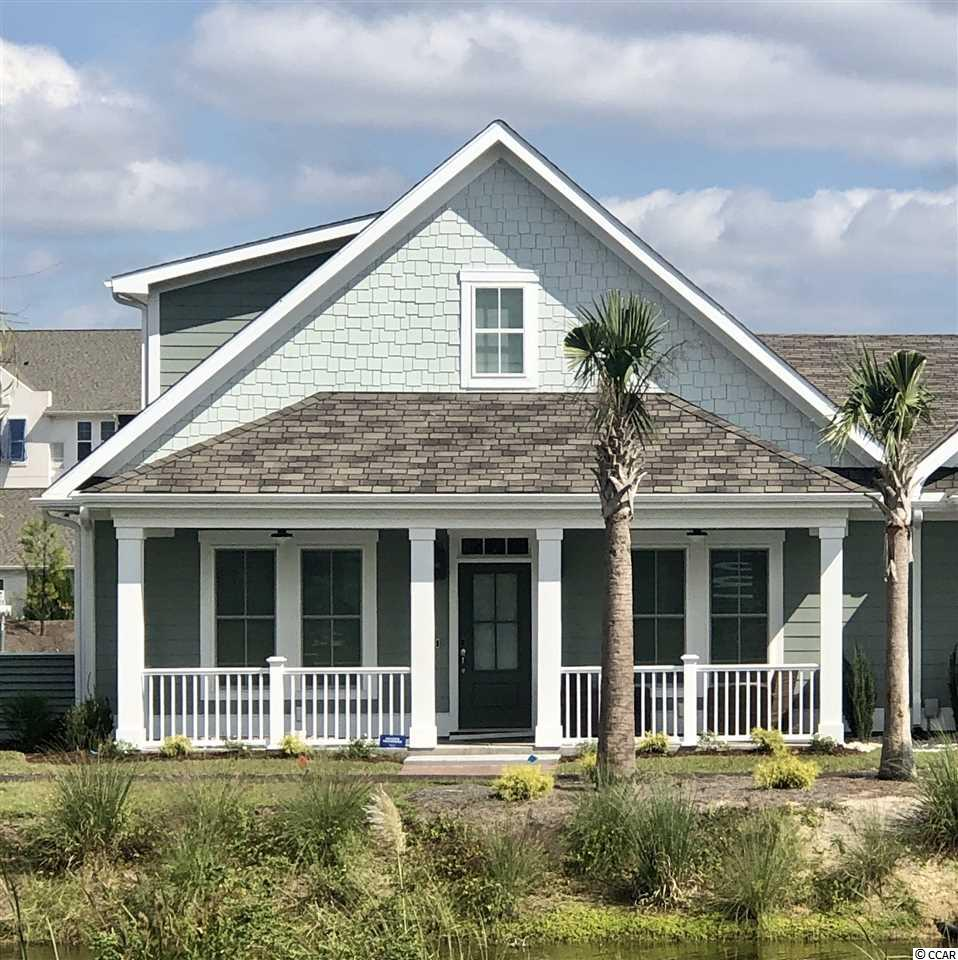 Be one of the first to enjoy the adorable Savannah Bungalow home plan in Living Dunes!  This duplex style home features 3 bedrooms and 3 full baths with an attached 1 car garage.  You can begin with picking your finishes to build the home to your style.  With over 1747 heated square feet, this home has an open kitchen, dining and living, the master bedroom and guest bedroom with 2 full bathrooms all on the first floor, and a nice sized 3rd guest bedroom with walk in closet and full bathroom upstairs.  There is also a ton of walk up storage space in this home! The master suite has two large walk-in closets and a master bath with double sinks and a walk-in tiled shower.   The pictures shown in this listing are from a former Savannah Bungalow already built/sold and that model included the upstairs storage converted into a bonus room, as well as other designer upgrades. Call today to learn more about this specific bungalow to-be-built home and pick your finishes!   Quality construction is a priority at Living Dunes. All homes built with 2x6 exterior walls, spray foam insulation, tank-less water heater, high impact-resistant windows, architectural shingles, custom Elmwood cabinetry certified by Environmental Stewardship Program, Smart home package features in ceiling speakers, keyless entry, Ecobee thermostat, remote view able security, irrigation, along with other apps all operated via the brilliant system and your own smart phone! Living Dunes is a boutique community, sits less than 1/2 a mile from the beach where residents have gated parking and full access to the beautiful, resort like, amenities of the exclusive Grande Dunes Ocean Club. Living Dunes is walking distance to great restaurants and shopping. Enjoy the on-site amenities of 8 miles of paved walking trails and sidewalks, large free-formed pool with zero entry and tanning shelf, clubhouse, outdoor event area and wood burning fireplaces and pockets of green space. Experience a higher standard of living today.