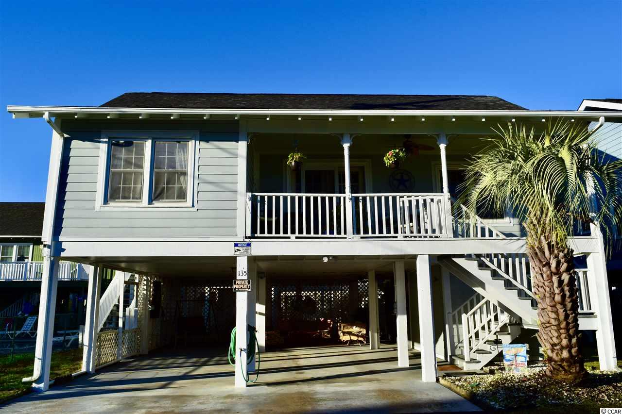 Don't miss out on this opportunity to own your slice of paradise in a fantastic location just footsteps to the beach with NO HOA! Your family will love making memories in this three bedroom home along with two full baths. You will love to hear the sound of the ocean from your front deck and the beautiful views of the Marsh. How about enjoying family time right out your back door on the 2019 newly built sundeck with plenty of room for gatherings. The master bedroom with it's own private bathroom features a walk-in closet, a ceiling fan, and a shower and a tub combination with single vanity area. The other bedrooms features ceiling fans as well and come with access to a full bathroom featuring a walk in shower and single vanity area. This home also features new Hardie Plank just installed in 2020. Under the house you can enjoy and relax with plenty of room for family gatherings with his own custom bar area. This would make the perfect primary home close to the beach, second home, or rental property. Garden city has some of the best dining, shopping and entertainment, and it's in close proximately to Myrtle Beach and Murrells Inlet. You don't want to miss out on this opportunity to own a the Beach Home you always wanted. Seller is a licensed Realtor in South Carolina.
