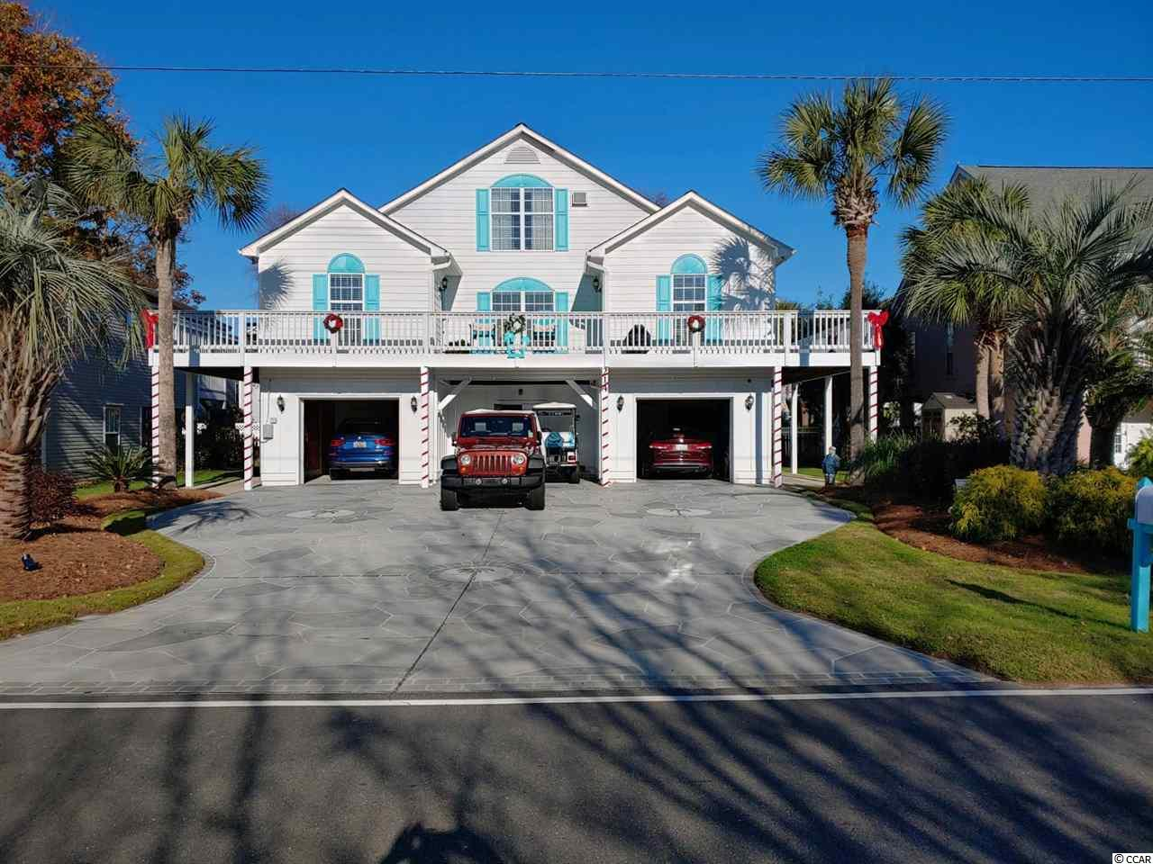 214 Melody Lane, known as Dream Vacation, is located oceanview, 11 homes from the sand in the Town of Surfside Beach. The home is seven bedrooms, seven and a half bathrooms, measures 5500 heated square feet and comes with a private heated pool. The interior is meticulously decorated and maintained, and the owner has made improvements that will make this raised beach house feel like a home. On the main level, there is a large oceanfront living room, dining area, that leads to two well-appointed kitchens highlighting granite countertops, shaker style white 42-inch cabinets, and stainless-steel appliances. Upstairs you'll find four more bedrooms, and four bathrooms. The exterior is wrapped in concrete fiber siding, parking for 6 cars, storage shed, and fenced in yard with pavers surrounding a custom heated pool. With access from the house, the twenty-five-foot covered back porch leads to the backyard.  You're just steps away from the Surfside Pier, the small downtown restaurant district, and minutes to all Myrtle Beach has to offer. The home has never been rented but would be fantastic rental property if investing is what you have in mind.   Why continue to rent when you can own your very own private beach retreat.