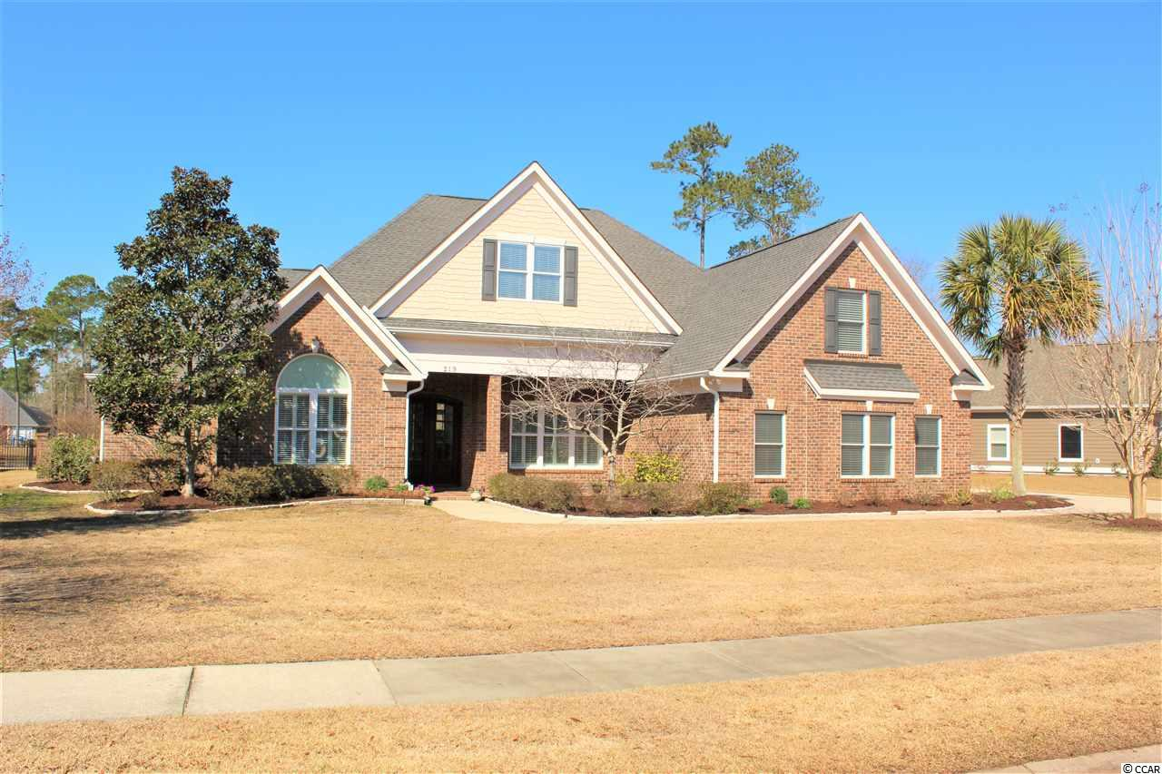 This spectacular lakefront home located in the gated, prestigious Cypress River Plantation is a must see! Absolutely stunning inside and out, no detail has been missed in this all brick 3 bedroom 2.5 bathroom home on .63 acres of land. Wonderful features include coffered ceilings, architectural details throughout and custom built-ins. Great floor plan with an office/den just off the elegant foyer, a formal dining room and a spacious living with fireplace and built in bookcases. The kitchen is a chef's dream with stainless appliances, granite countertops and beautiful cabinetry plus a breakfast room. The luxurious master suite includes a tiled walk in shower, jetted tub and double vanities with granite countertops. In addition, there is a bonus room over the garage-perfect for a media room or playroom. Throughout the home an abundance of windows let in beautiful natural light. Outside lush landscaping surrounds the home and the covered patio is the perfect spot for entertaining and enjoying those outstanding lake views. This fabulous waterway community has great amenities including a pool, clubhouse, fitness center, boat ramp, boat/RV storage and a picnic area. Perfect location –tucked away from the hustle and bustle but only minutes to shopping, dining, the airport and the beach. This is the dream home you have been searching for and proof that yes, you can have it all! Make an appointment to view this outstanding home today!