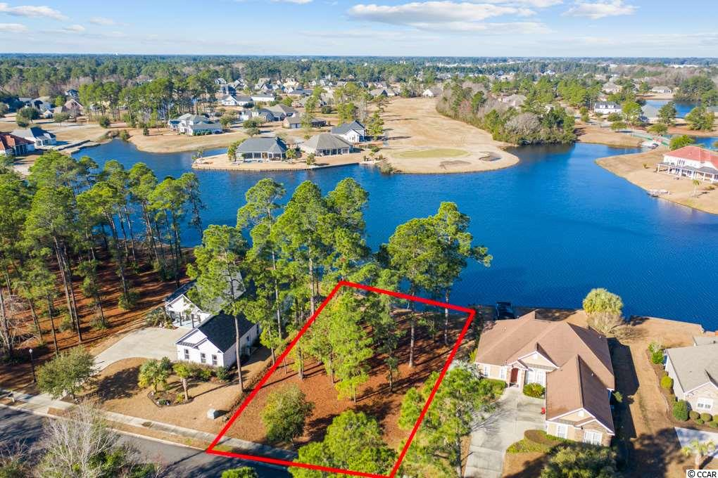 Premium lake front lot at .41 acres of buildable foot-print with 85 ft. of lake frontage with Golf course views opposite of lake. Located in the highly sought after lake/golf community of Wild Wing Lakes. Boat through the navigable 180 acre lake directly to the top of the line amenity center and clubhouse with fitness center, driving range, 3 pools, water slide and kids area, day docks and boardwalk. Close to universities, Conway Hospital, downtown Conway, shopping, dining, and entertainment. Short drive to the beach and downtown., No time frame to build. Choose your own builder.