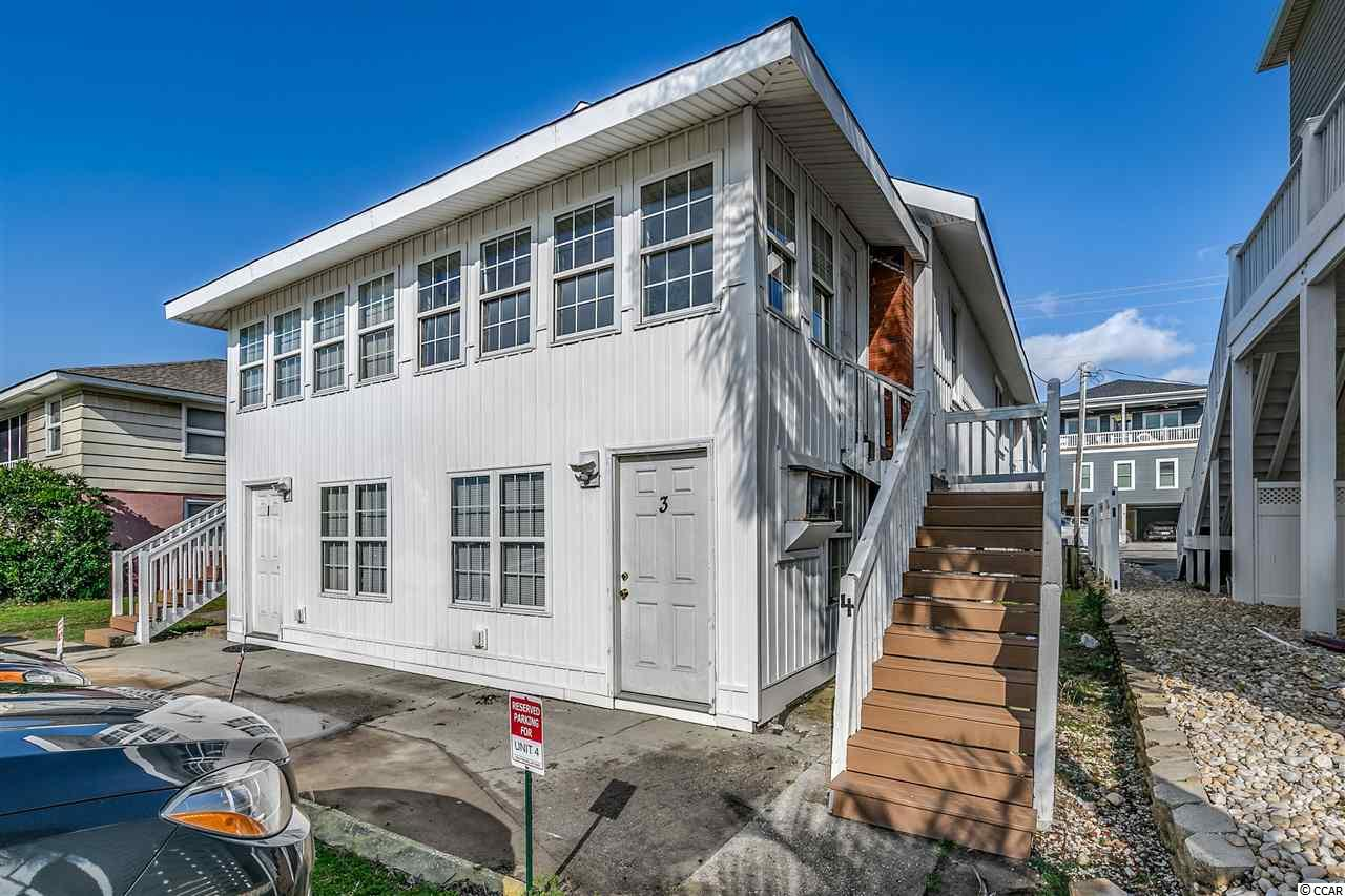 Rare find! Across the street from the Ocean!!! Enjoy six rental units on this property.  Four 2 bedroom units and two - 3 bedroom units  You must view to appreciate the location and potential!  Don't Delay!