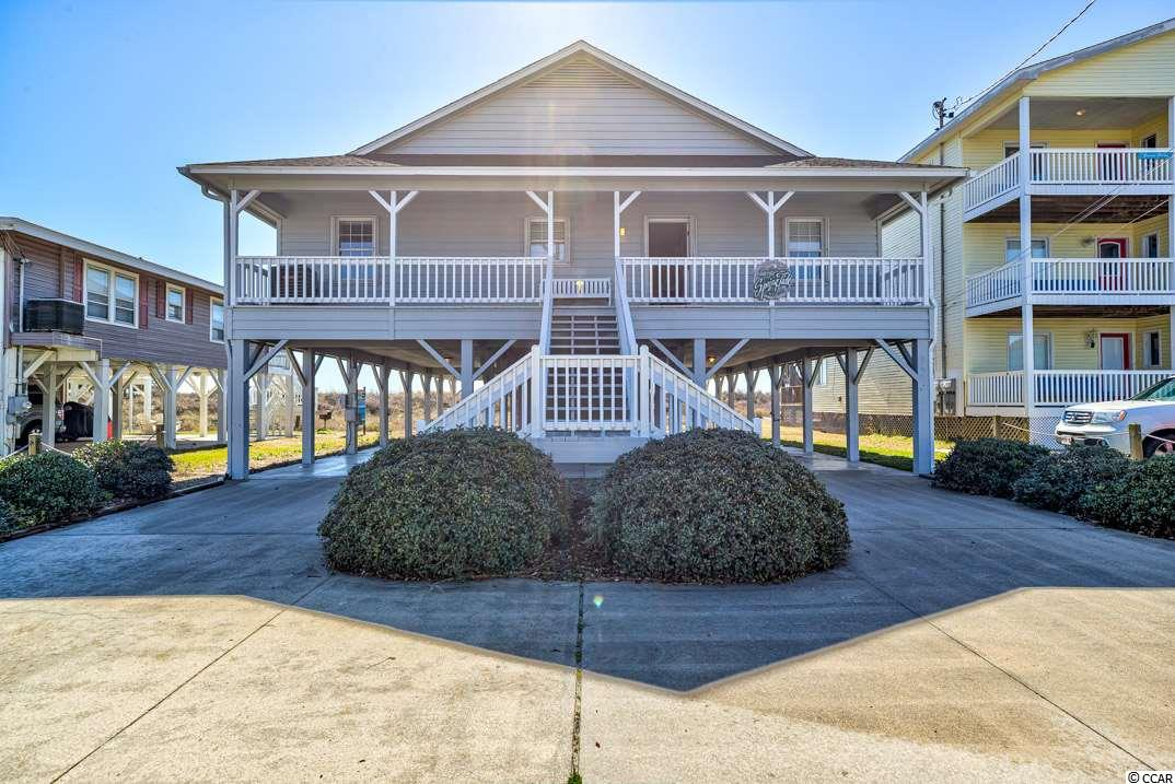RARE OceanFront Raised Beach House with 4 Master Bedrooms located in the Highly Desired Cherry Grove Section of North Myrtle Beach! This Property will sleep 16 people and  is 40 Years Younger Than Most of the ones Surrounding it.  Perfect for a Vacation Home, Primary Residence, or a POWERHOUSE Rental Property, this place is LOADED with One of a Kind Features such as a Wet Bar, Dual Outdoor Heated Showers, and a HUGE Oversized Deck - So Big The Owner had to Obtain a Variance to Build it!  This is an Absolute Prime Property Sold 100% Turn-Key with All the Furniture and a TV in Every Room.  Don't Delay - Come See TODAY!