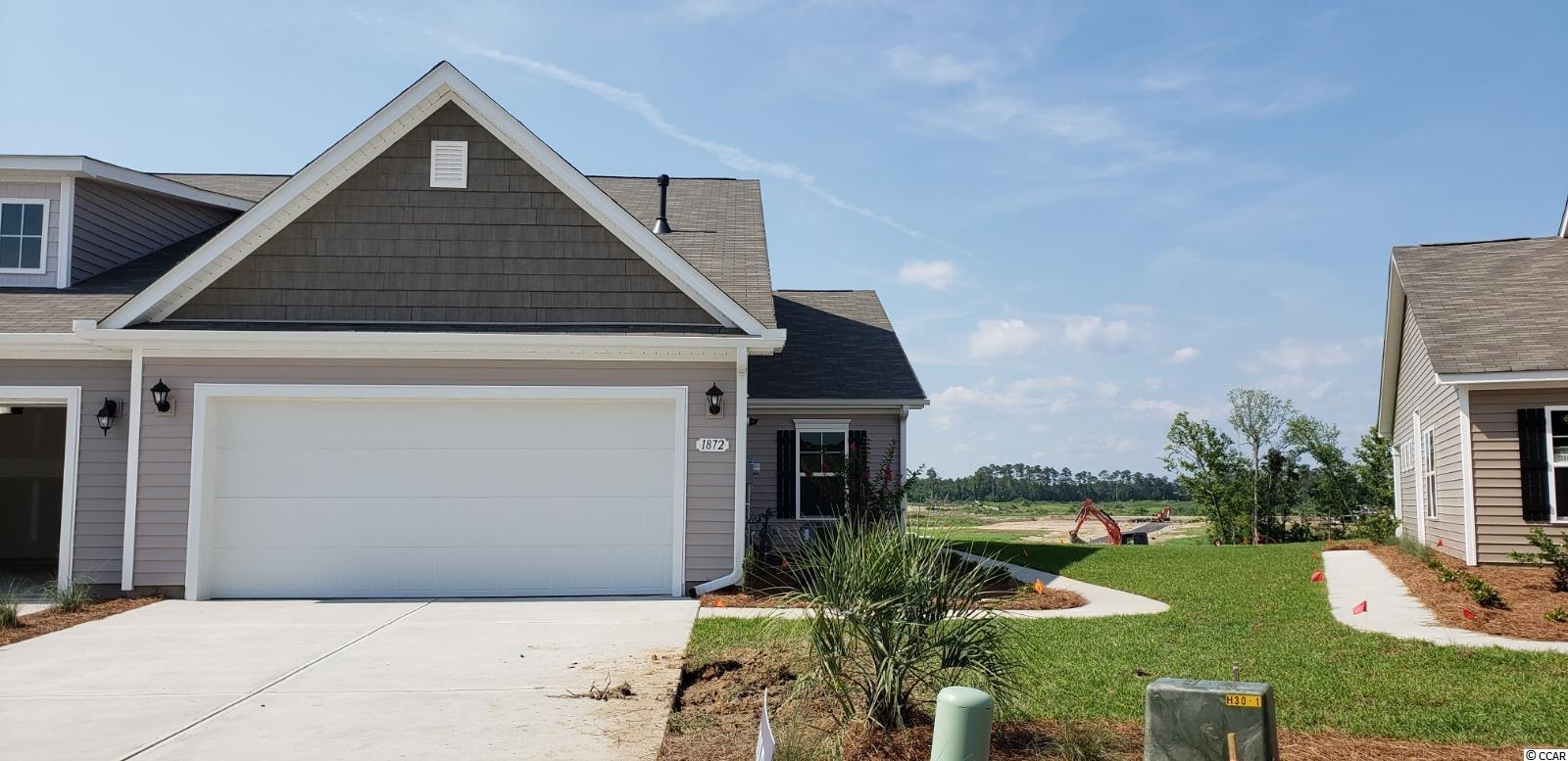 Lovely, low maintenance, paired ranch home in a brand new community! This Tuscan floorplan offers a spacious, open layout all on a single level. With vaulted ceilings, tons of natural light throughout the living and dining areas, large kitchen island with breakfast bar, and spacious rear screen porch, this home is perfect for entertaining! The kitchen also features granite countertops, stainless steel appliances, modern gray painted cabinetry, and large pantry with ample storage. Roomy primary bedroom suite with walk-in closet and private bath with dual vanity and 5 ft. walk-in shower. This home also features laminate wood flooring throughout the main living areas, a tankless gas water heater, and our industry leading smart home technology package. Yard and exterior maintenance are all covered! 4' black aluminum fencing is permitted (per HOA approval).  *Photos are of a similar Tuscan home. (Home and community information, including pricing, included features, terms, availability and amenities, are subject to change prior to sale at any time without notice or obligation. Square footages are approximate. Pictures, photographs, colors, features, and sizes are for illustration purposes only and will vary from the homes as built. Equal housing opportunity builder.)