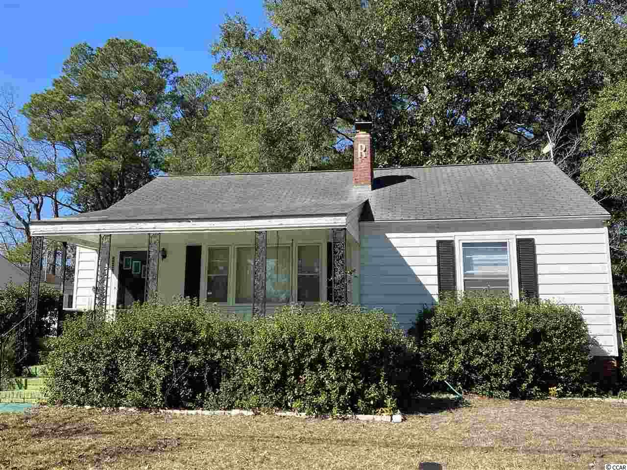 Great opportunity to own this home in Maryville which is near Winyah Bay and local boat landings and close to Historic Downtown Georgetown with its award winning restaurants and shopping.  This home features hardwood floors in the main living area, fireplace and pull down stairs with extra storage in the attic.  It includes a large 24'x30' detached Garage with a shop inside for all your projects.  The home has a lot of potential bonus space with an attached enclosed back porch.  Needs TLC to make this the perfect home for a family or investment rental.