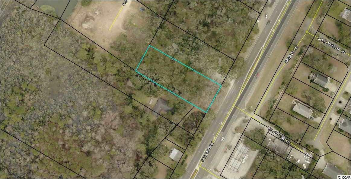 Commercial Lot located directly on Ocean Highway/Highway 17 Frontage in Pawleys Island. Zoned General Commercial (GC), offering many uses for this lot. Beautiful Live Oaks on Lot and Easy Access. Located just before Traffic Light at Martin Luther King Road. The possibilities are endless with this gem of a lot!