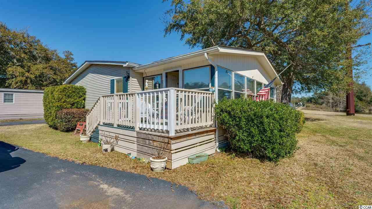 Lovely bright and sunny 3 bedroom, 2 bath home located in the quiet 55+ community of Inlet Oaks Village.  Located just across the street from Huntingdon State Park and not far from the Marsh Walk and all of the fine attractions and fine dining that Murrells Inlet has to offer.  Soak in the water view from the kitchen and Carolina Room which overlook the pond which you can enjoy while soaking in your indoor hot tub located in the same Carolina Room. Luxury wood vinyl throughout with the exception of one bedroom which does have carpet.  Home is move in ready and offers 2 outdoor sheds for storage.