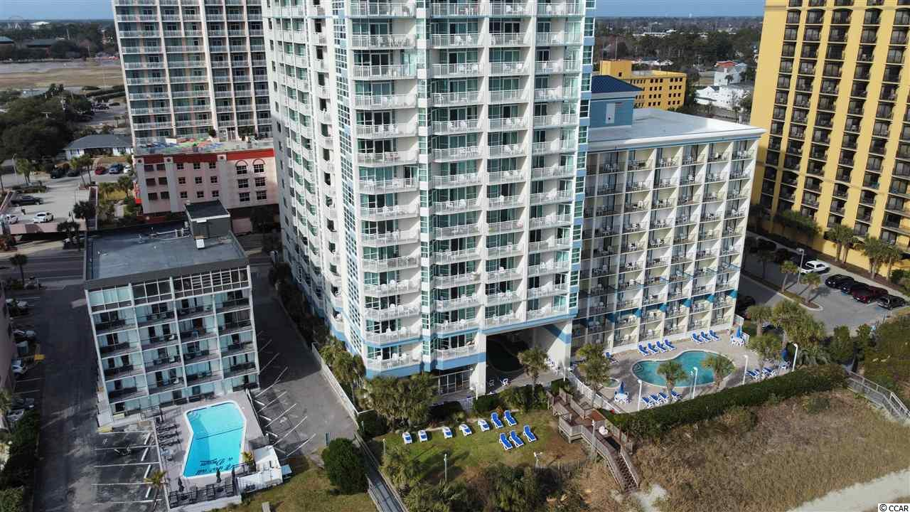 Wow! This amazing Oceanfront End Unit has been tastefully renovated and updated.  Spacious Open Floor plan with uncompromised ocean views. New granite countertops in the fully appointed Kitchen. New LVT plank flooring in most of the living areas and brand new comfortable furniture.  Washer and Dryer in unit is a wonderful convenience. The Carolinian is one of Myrtle Beach's most sought after vacation spots.  The resort features Oceanfront pool, Lazy River, Hot Tub, Fitness Center, great location and amenities. You have a front row seat to the 4th of July fireworks from your balcony.  Enjoy this unit for your personal use or rent it out for great rental potential.  Close to Broadway and the Beach and all the great Myrtle Beach attractions.