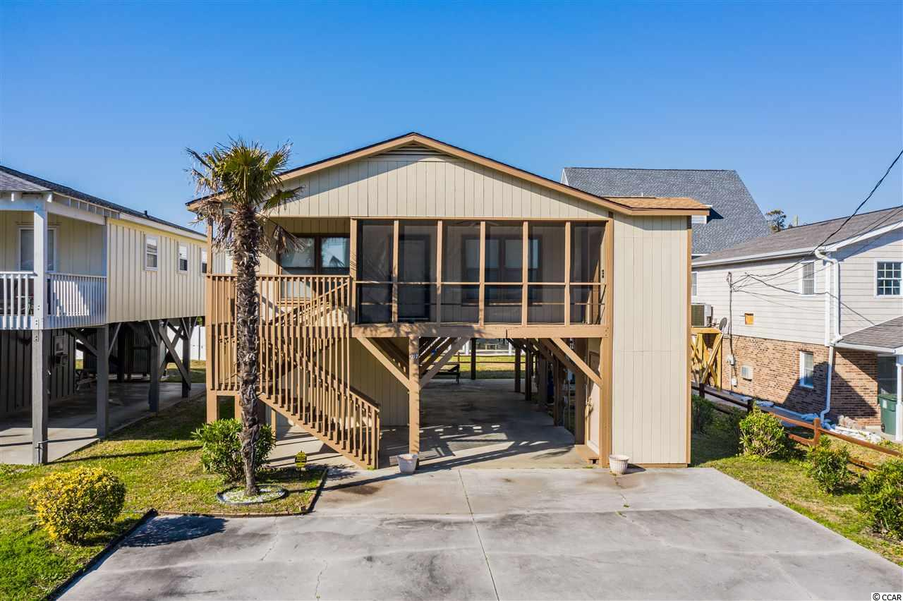 Plenty of Coastal Charm in this Raised Beach House in North Myrtle Beach, SC. Located just a short walk to the sandy beaches of Cherry Grove, this 4BR, 3BA Cottage is move-in ready! Don't like climbing stairs? No worries, it has an elevator! Interior features include: 1496 HSF, 2 bedroom suites, 2 additional bedrooms split by a Jack & Jill Bath, Kitchen with tile floors, Window treatments, Skylights in the Great Room, Ceiling fans, & a Security system. Exterior features include: Screened front porch, Enclosed elevator, large open sundeck, Storage room, newer roof, & a Large driveway. This home still owned by the original owner is ready to make new beach house memories for a new family or become an income producer for an investor. Buyer &/or their Agent are responsible for verification of any provided information in this listing.