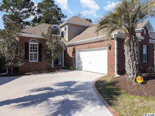 Welcome home to this beautiful brick 4 bedroom, 3 full bath home in the lovely community of Charleston Place on the prestigious Myrtlewood golf course! This home features an open living area with wood floors, plenty of natural light and a cozy gas fireplace, an open kitchen with plenty of white cabinetry and a sunny breakfast area, and a vast private patio with a serene golf course view. The first-floor master suite offers a private glass door patio entrance, sitting area, walk-in closet, and an ensuite bath with a dual sink vanity, garden tub, and wide walk-in shower. New roof installed in 2016, new HVAC system installed in 2020, and energy-efficient solar panels are included. The Charleston Place location is just minutes to the beach and all the shopping, dining, and entertainment the Grand Strand has to offer!