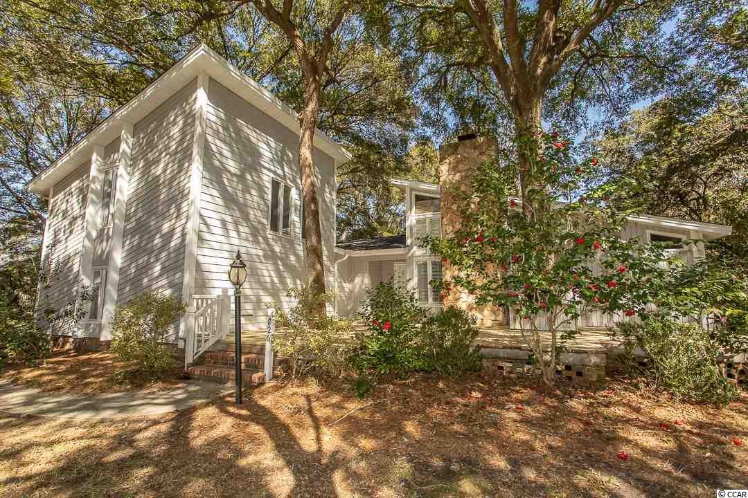 An amazing find in one of the best neighborhoods around!  The home sits under several mature oaks and offers a yard that is just under half acre in size.  There is so much potential here to enjoy the wonderful climate associated with Murrells Inlet.  There is even a small workshop in the back corner for lawn tools or converted she-shed!  Arriving on the massive front porch you'll know that this is where you'll get to know the neighbors.  In the shade and amongst the natural elements many conversations will take place enjoying sweet tea!  Open the front door to see a home updated days ago with all new flooring, all new paint and yes, even a brand new roof!  The Family Room is straight ahead, but your eyes will be draw the the huge sunroom in the back that finds a way to filter the sunlight in through the oaks out back.  The Kitchen is to your left with an easy pass-through to the informal Dining area between the Sunroom and Family rooms.  The split plan places the Owners Suite on the right side of the home and the other bedrooms on the left.  Through the mudroom/utility room is the staircase to the very private room upstairs.  What a perfect work-from-home office location or even a place to have guests enjoy while visiting.  Plenty of closet space and beautiful new flooring.  This home is move-in ready and needs very little personalization to start enjoying the first day you own it.  If your top three search criteria include great house on a great lot and in an amazing neighborhood then you better come over to see this one today!  Contact the Listing Agent directly for the most current information on this listing.