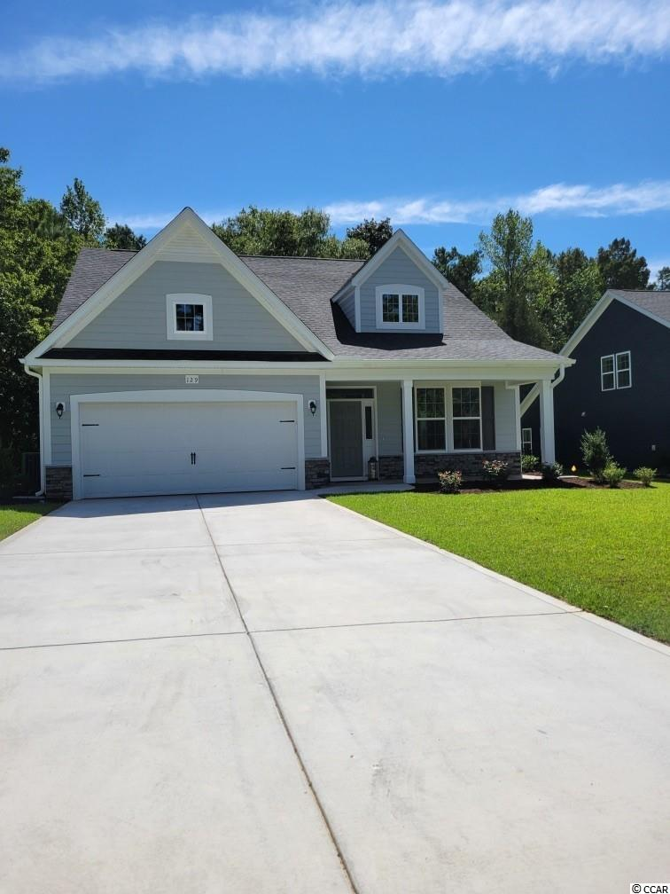 """This 1/2 acre home site is a must see!  Small pond and trees in the rear of this home site are beautiful.  This approximately 2000 sq ft, Kent home plan, offers 4 bed/ 2.5 baths, with Master bedroom on the First level of the home.  The Family room, with a vaulted ceiling, will have a gas Fireplace and opens into a large Dining/Kitchen area.  The Kitchen offers plenty of storage with painted, staggered cabinets with crown molding and an Island Bar for in-Kitchen dining.  5"""" Laminate flooring will cover the entire main living areas.  Buyers will love the gorgeous Tile in all the baths and laundry room.  The master bedroom has a beautiful bay window overlooking the natural area in the rear of the home.  The Master bath will have an All-tile shower with a glass door. Oak tread stairs will lead up to the spacious upstairs which has 3 nice size bedrooms, 2 with walk in closets, and a large loft area upstairs (15.10x9.6).  The huge walk-in storage space over the garage is a must-see! Relax and enjoy the view from your front or rear covered porch.  This home is built with 2x6 construction, and is an eco-select home with R-19 insulation, 16 seer HVAC, radiant barrier in the roof line.  This also includes gutters, irrigation system, key pad/remote control entry for the garage, Taexx pest control system, just to name a few features of the home. Don't forget Free Greens fees at Shaftesbury Glen golf course!  Relax on the rear Deck of the clubhouse overlooking the Waccamaw River.  Enjoy eating at the Clubhouse bar and grill.  Relax by the Pool located at the Clubhouse.  Fish from the day dock located on the river.  Shaftesbury is a fun, active community! Photos are of a similar Kent home. (Home and community information, including pricing, included features, terms, availability and amenities, are subject to change prior to sale at any time without notice or obligation. Square footages are approximate. Pictures, photographs, colors, features, and sizes are for illustration purpos"""