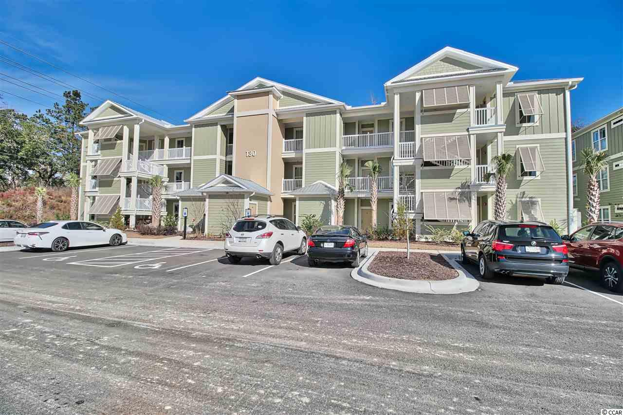 Located in the heart of Pawleys Island, this 1st floor condo offers easy and convenient coastal lifestyle living. An affordable opportunity to have your own place at the Beach. Elevators and a pool, hardwood floors, granite countertops, and a screened porch are a few of the details you'll love! While being located near public tennis courts, a fitness club, shopping and dining, you are also only a short drive to the beach, the river, golf courses, marches and marinas. This home offers all that you are hoping for in a SC beach community. Photos are same floorpan reversed in building 2 on 2nd floor. Hurry in while buyer can make finish selections.
