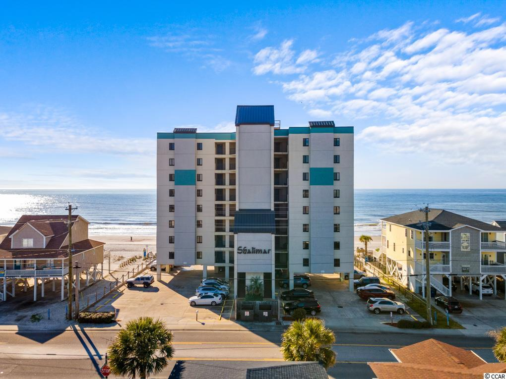 """Amazing oceanfront 3BR-2BA condo at Shalimar Resort in Cherry Grove in North Myrtle Beach. This unit has spectacular ocean views from almost every room, with beach front balcony (24ft) access from the living room, kitchen, and master bedroom. Plenty of room for all your guests with the large living & dining area, fully equipped kitchen and a breakfast bar. On each floor there are shared storage closets. This is the perfect beach get-away and/or investment.  Shalimar has a wonderful rental history. There's a beach front pool for residents & guests. Shalimar is in close to the Cherry Grove Pier, great restaurants, entertainment, """"Main Street"""" and many exceptional golf courses. Make an appointment today! This condo will not last long! Sold as is condition."""