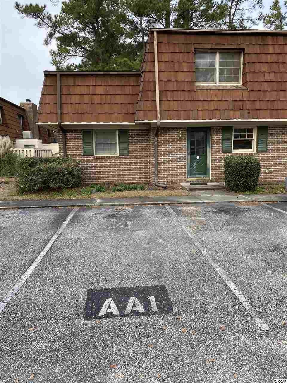 Great opportunity for rental income within walking distance of Coastal Carolina University! Perfect for the college student so close to campus! Huge brick fireplace in great room with laminate flooring. Assigned parking spaces, complex has pool and common areas for grilling and playgrounds. END unit offers larger living space.  All appliances convey including washer/dryer and refrigerator.  Close to beaches and shopping.