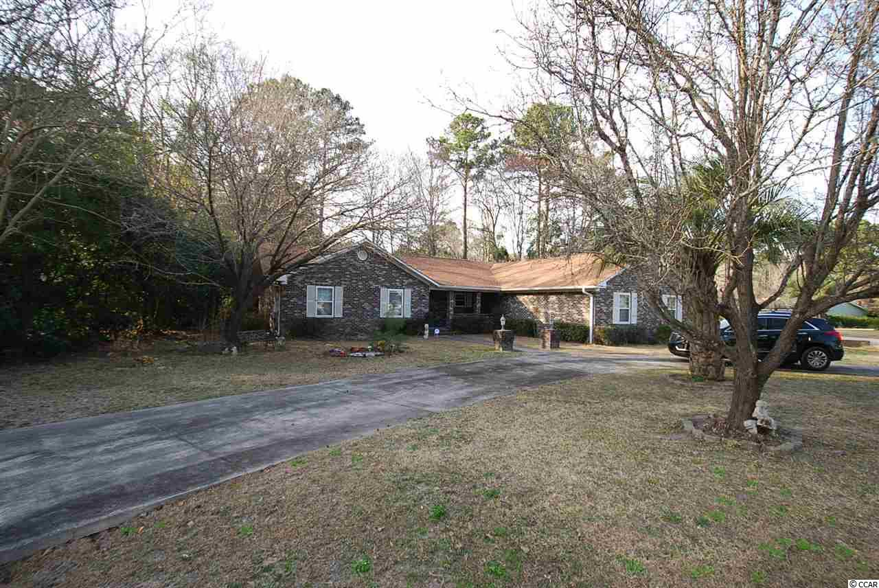 Don't miss out on this great opportunity to purchase a home just a golf cart away from the beach. Located on a corner lot of .48 acres in this sought after Deerfield Plantation is this all brick 3 bedroom 3 bath home with ample parking and a 2 car garage. With some TLC you can make this property suit all your needs. Featuring an oversized Livingroom, formal dinning room, eat-in kitchen, large bedrooms and bonus room with fireplace .  Irrigation system sold as is.